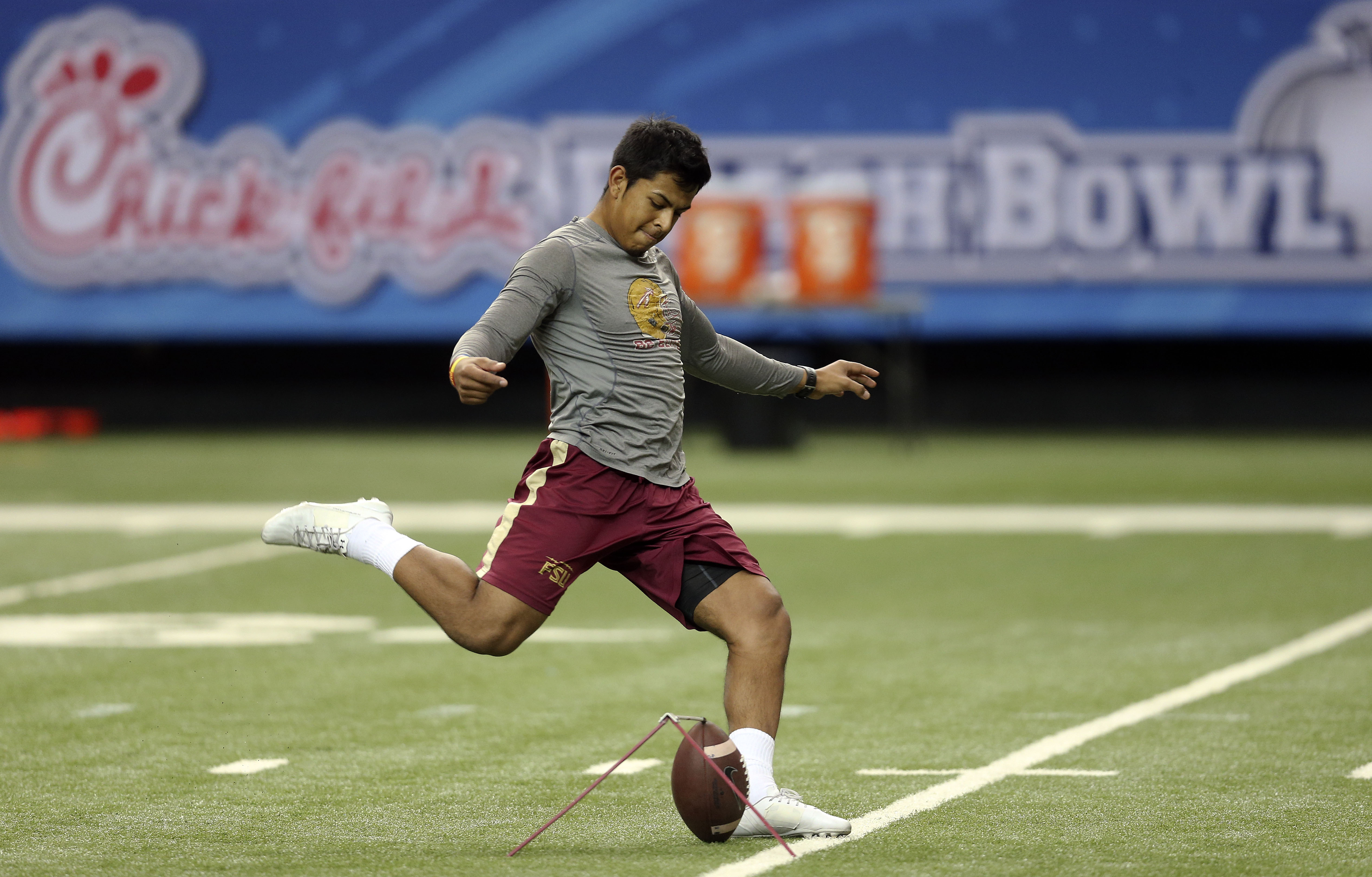 Florida State placekicker Roberto Aguayo (19) kicks during a practice for the Peach Bowl NCAA college football game at the Georgia Dome, Tuesday, Dec. 29, 2015, in Atlanta. Florida State will face Houston on New Year's Eve. (AP Photo/John Bazemore)