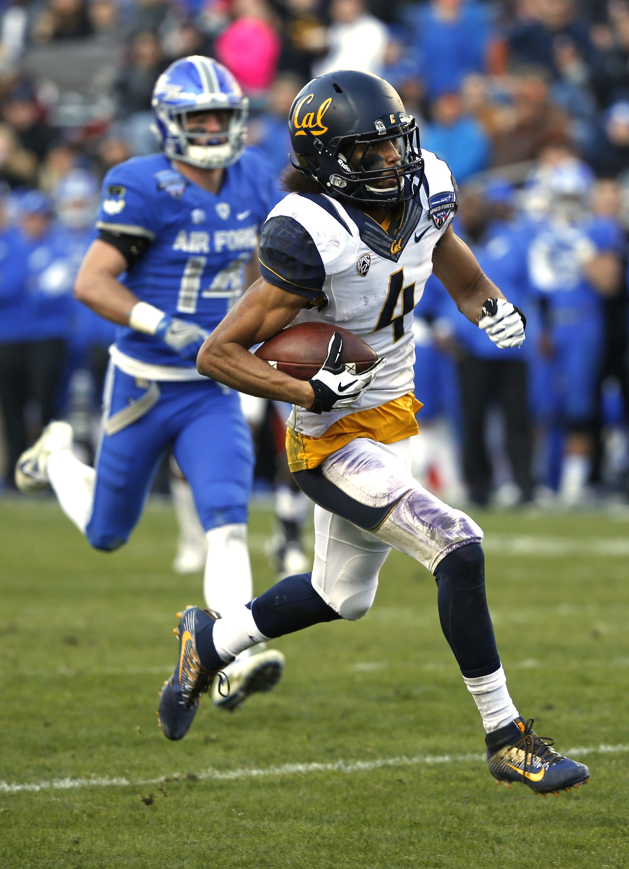 California wide receiver Kenny Lawler (4) takes the ball in for a touchdown against Air Force defensive back Hayes Linn (14) during the second half of the Armed Forces Bowl NCAA college football game, Tuesday, Dec. 29, 2015, in Fort Worth, Texas. Californ