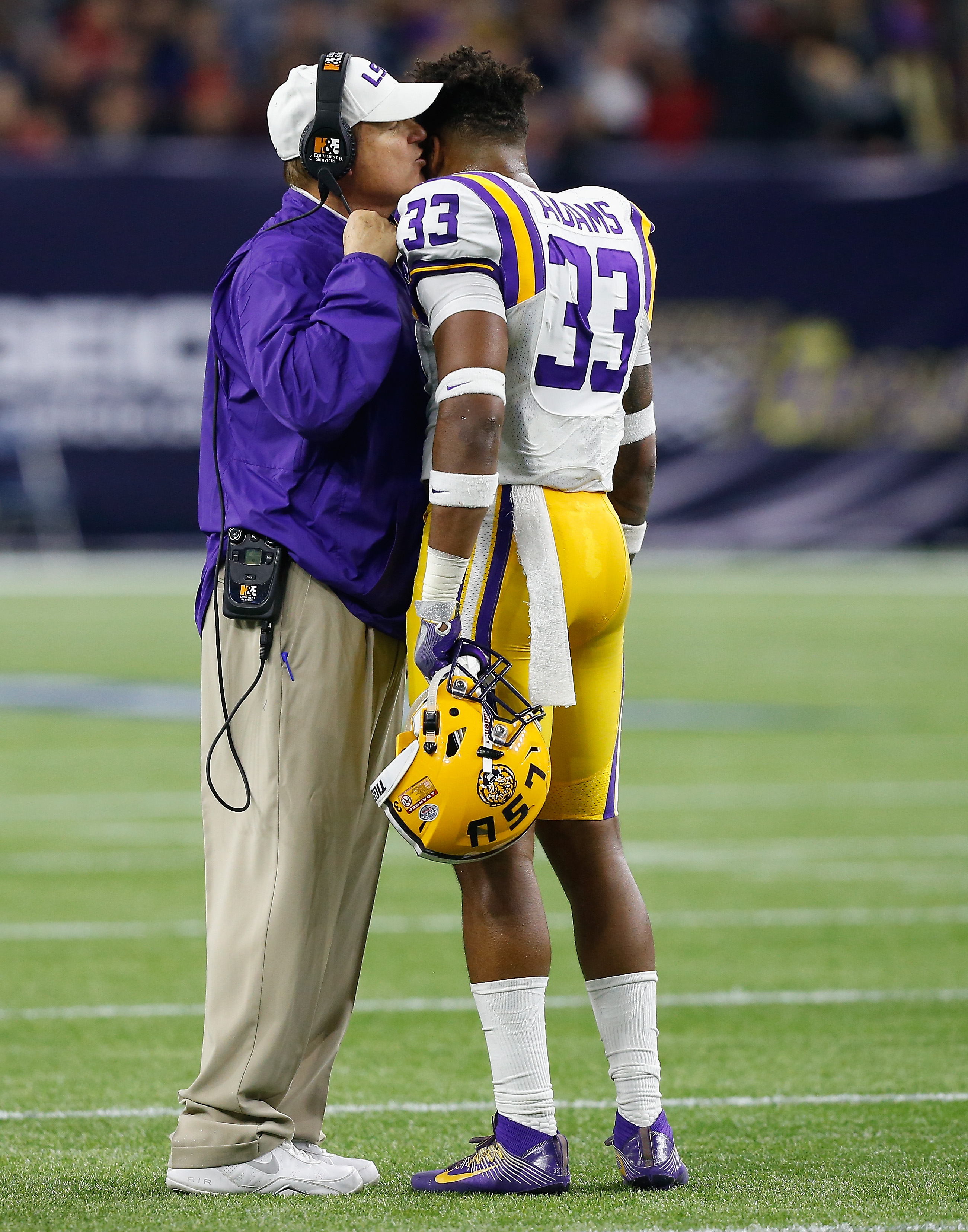 LSU coach Les Miles talks to safety Jamal Adams (33) during the first half against Texas Tech in the Texas Bowl NCAA college football game Tuesday, Dec. 29, 2015, in Houston. (AP Photo/Bob Levey)