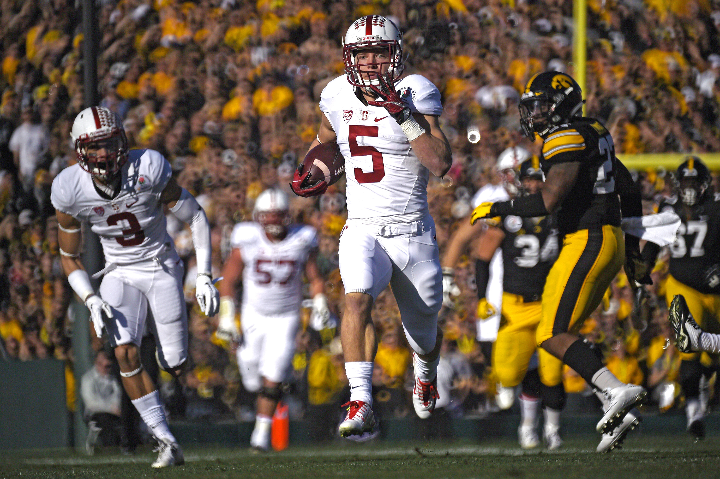 Stanford running back Christian McCaffrey scores against Iowa during the first half of the Rose Bowl NCAA college football game, Friday, Jan. 1, 2016, in Pasadena, Calif. (AP Photo/Mark J. Terrill)