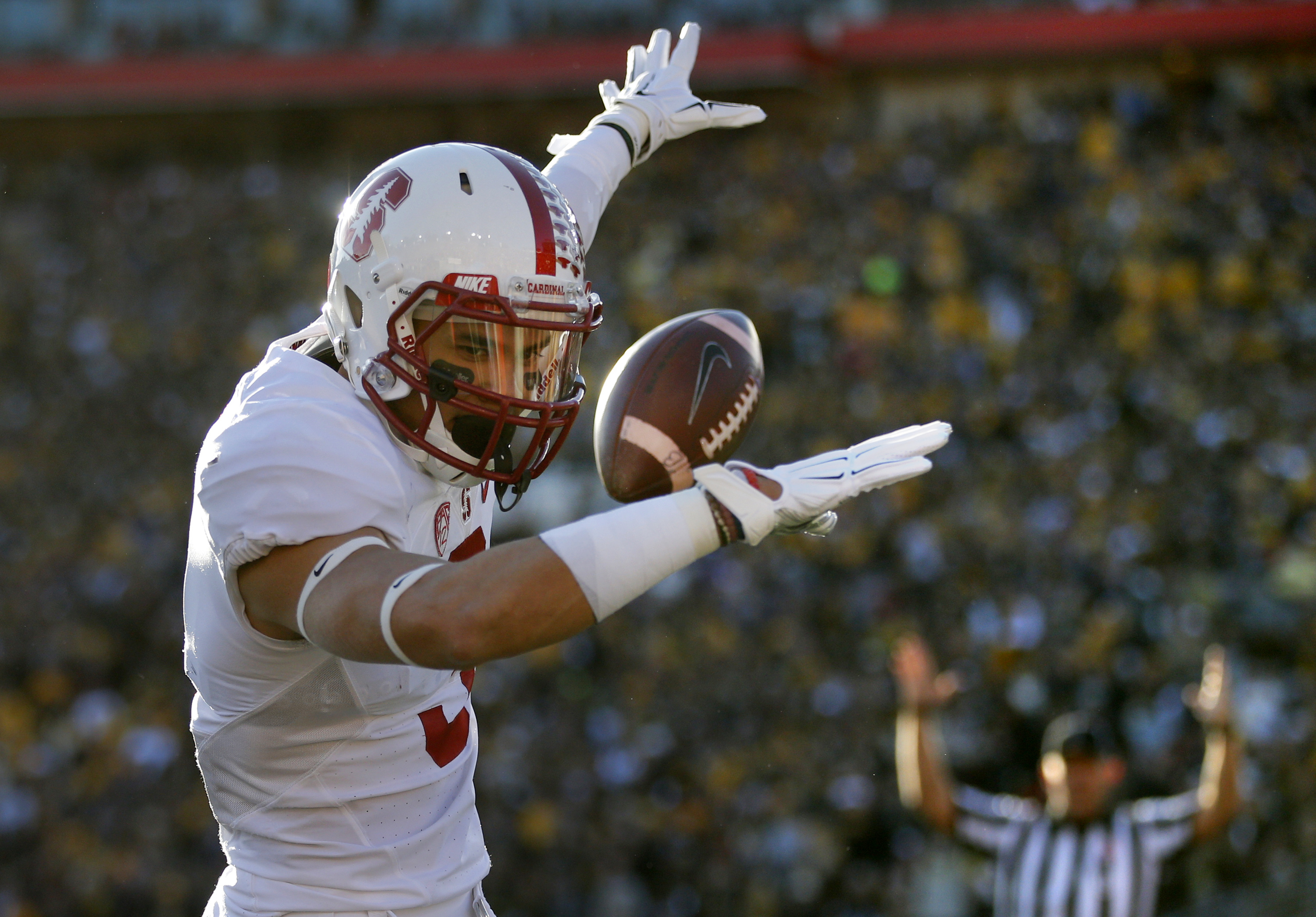 Stanford wide receiver Michael Rector celebrates after scoring against Iowa during the first half of the Rose Bowl NCAA college football game, Friday, Jan. 1, 2016, in Pasadena, Calif. (AP Photo/Jae C. Hong)