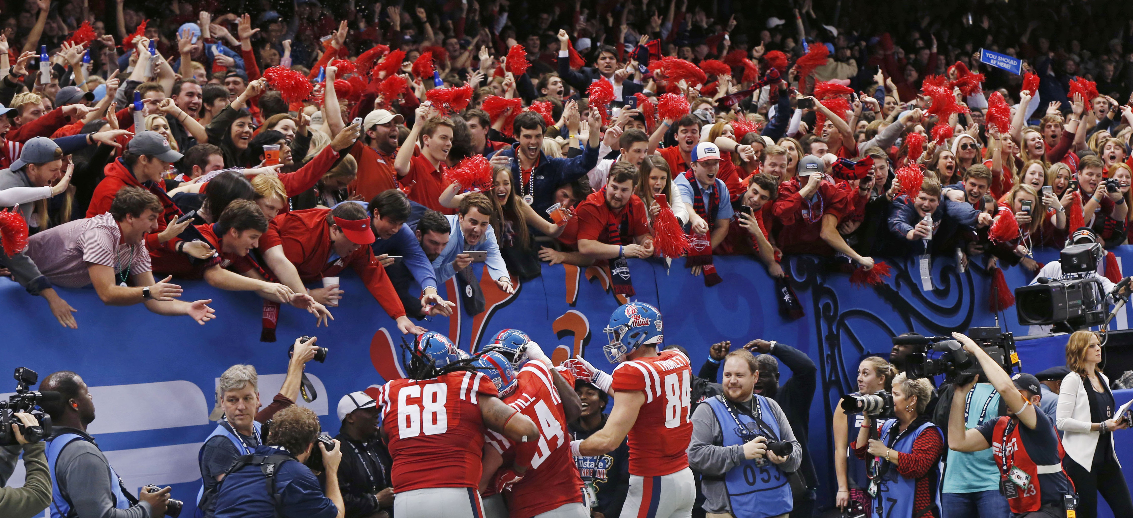 Mississippi players and fans celebrate after offensive lineman Laremy Tunsil (78) carried for a touchdown in the first half of the Sugar Bowl college football game against Oklahoma State in New Orleans, Friday, Jan. 1, 2016. (AP Photo/Bill Feig)