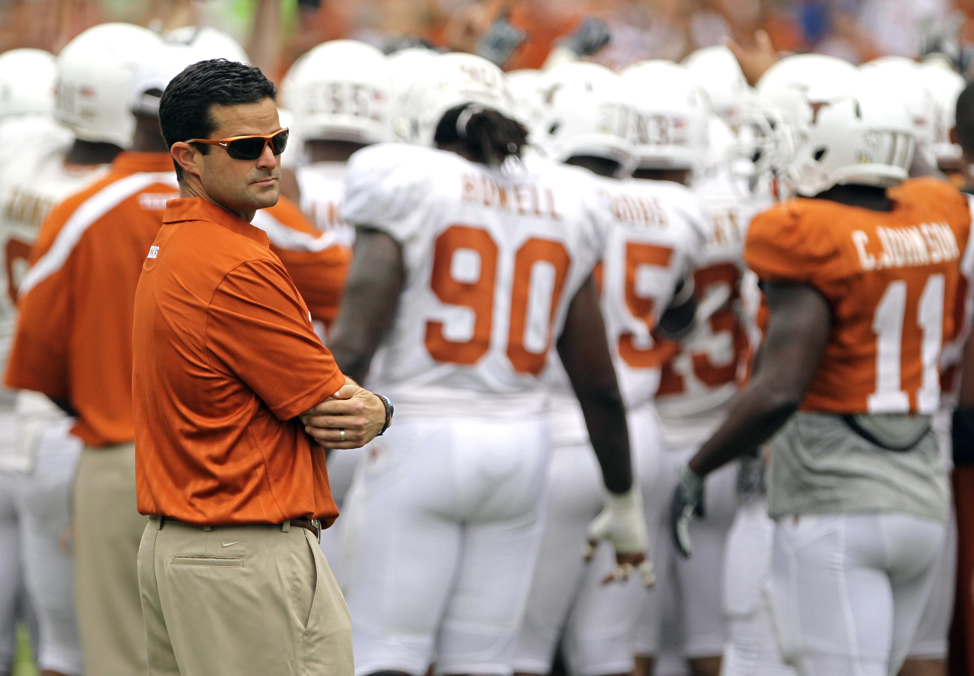 Texas' new defensive coordinator Manny Diaz looks on before  the Texas Orange and White spring football scrimmage on April 3, 2011, in Austin, Texas. The Orange team won 27-7. (AP Photo/Michael Thomas)