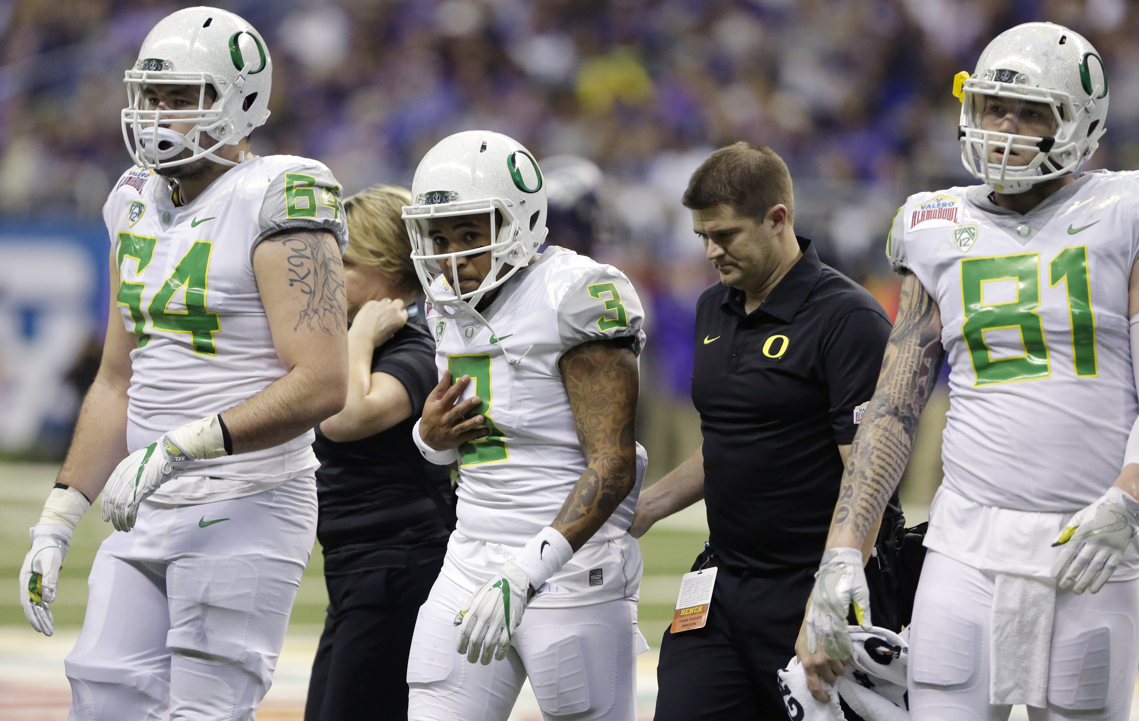 Oregon quarterback Vernon Adams Jr. (3) is walked off the field after he was injured during the first half of the Alamo Bowl NCAA college football game against TCU, Saturday, Jan. 2, 2016, in San Antonio. (AP Photo/Austin Gay)