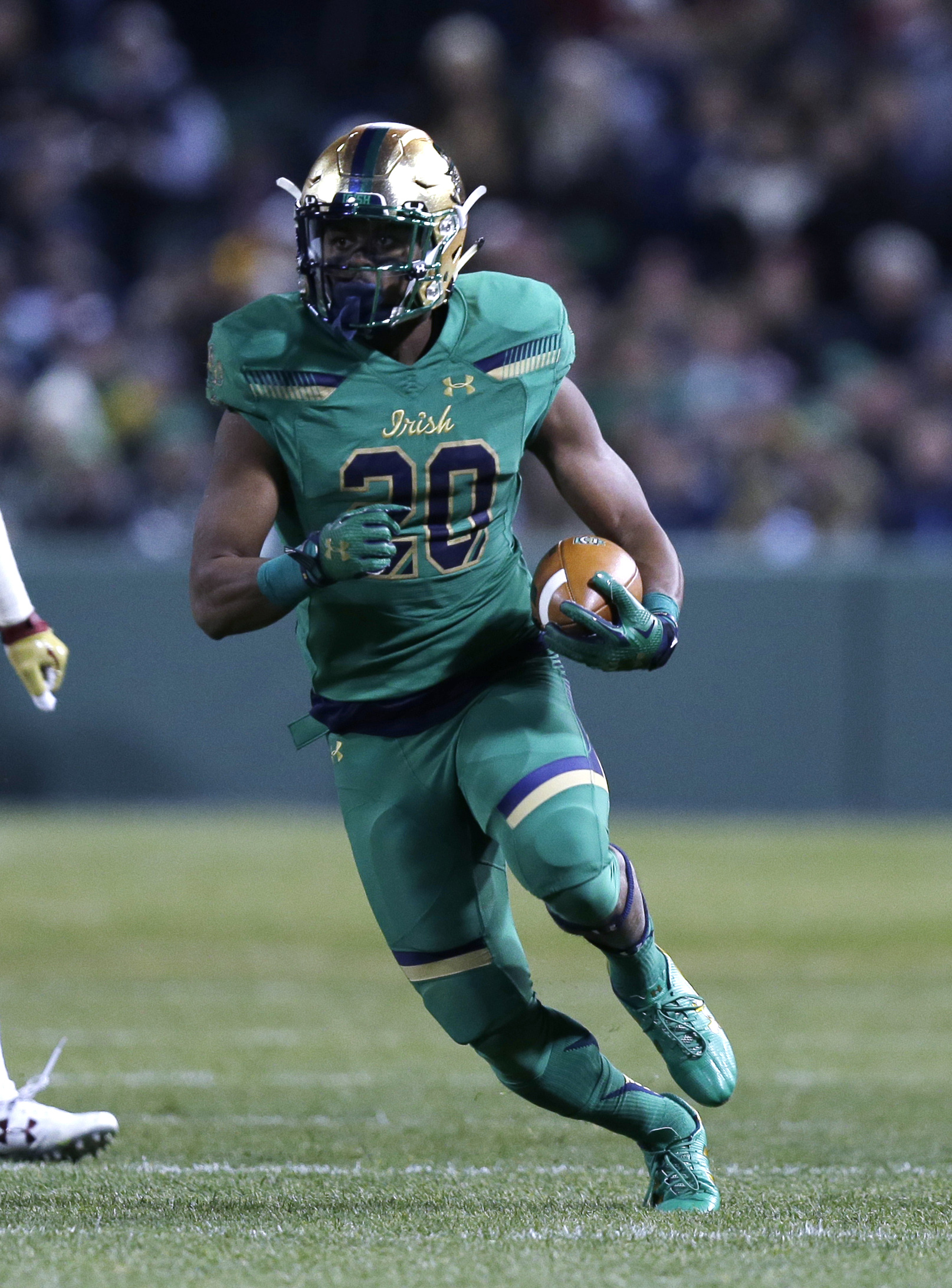 Notre Dame running back C.J. Prosise (20) during the first half of the Shamrock Series NCAA college football game at Fenway Park, home of the Boston Red Sox, in Boston Saturday, Nov. 21, 2015. (AP Photo/Charles Krupa)
