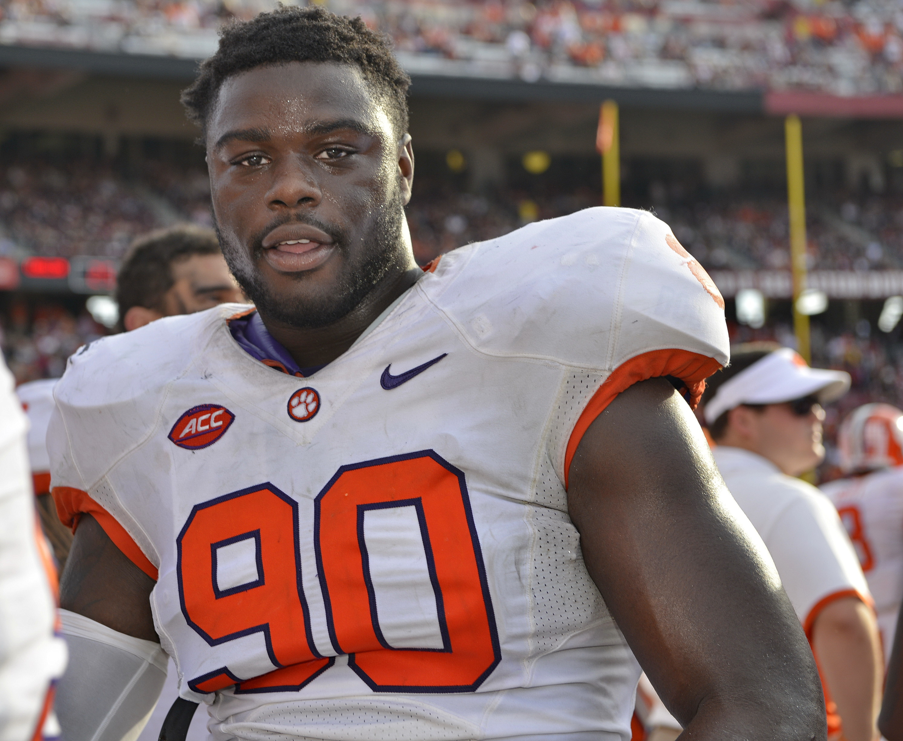 "FILE - In this Nov. 28, 2015, file photo, Clemson's Shaq Lawson looks on from the sideline during the second half of an NCAA college football game against South Carolina, in Columbia, S.C. Clemson coach Dabo Swinney says he is ""very optimistic"" All-Americ"