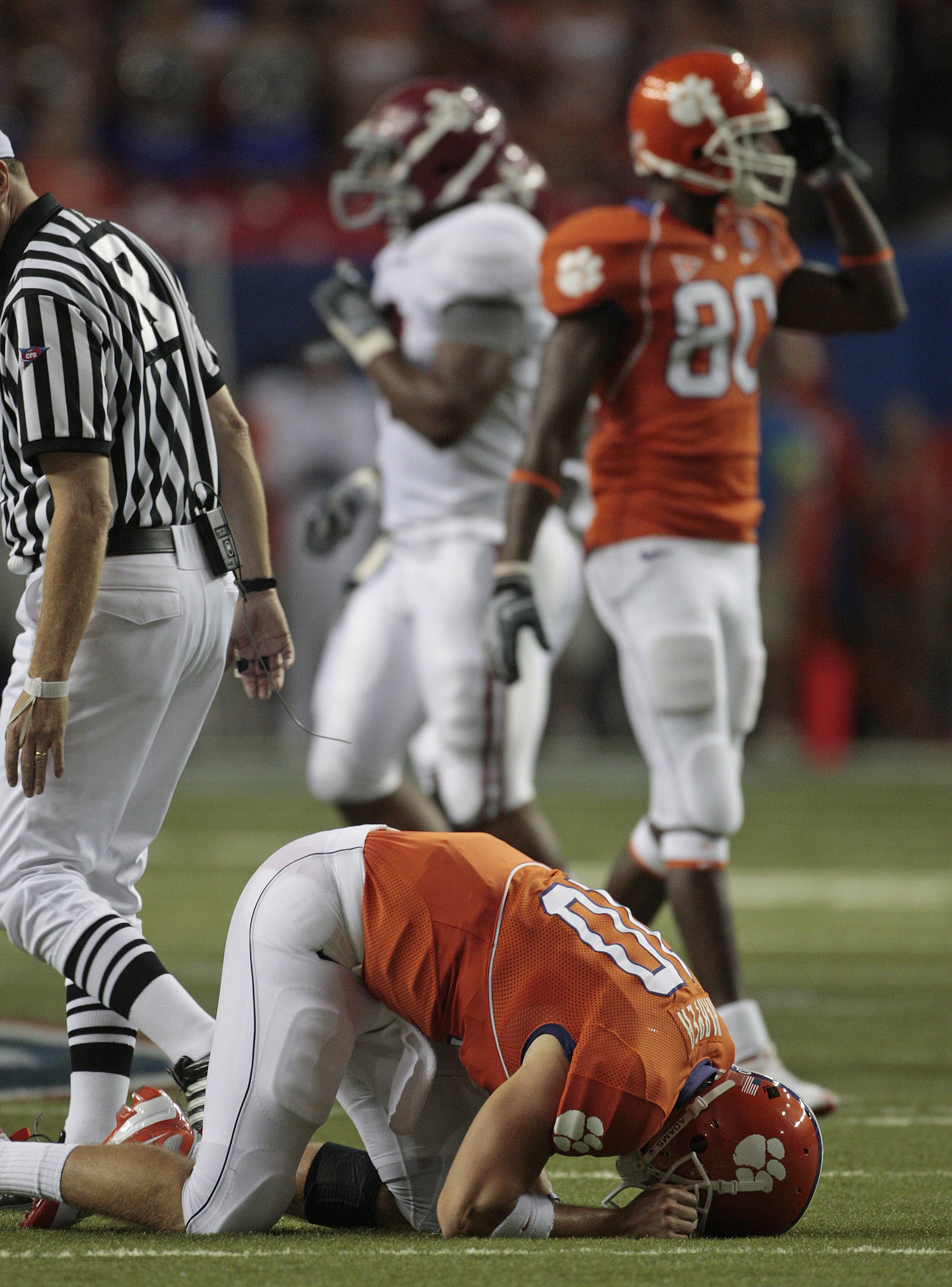 FILE - In this Aug. 30, 2008, file photo, Clemson quarterback Cullen Harper (10) gets up slowly after a hard hit by the Alabama defense during the second quarter of their football game at the Georgia Dome in Atlanta. Alabama defeated Clemson 34-10. Alabam