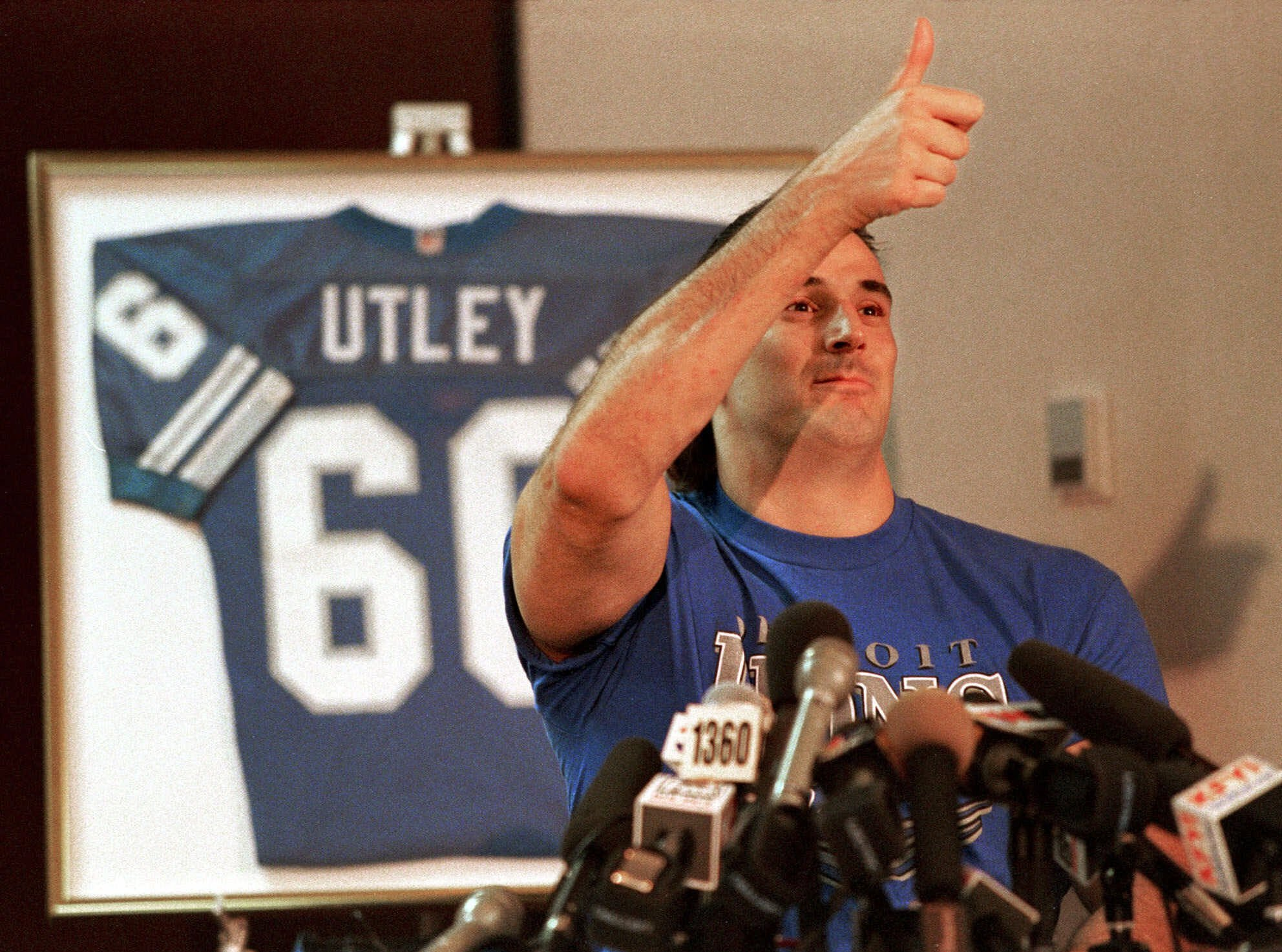 FILE - In this Feb. 15, 1999, file photo, former Detroit Lions guard and Washington State lineman Mike Utley gives the thumbs-up after successfully walking from his wheelchair at a Phoenix hotel. Utley, who suffered a spinal cord injury during an NFL game