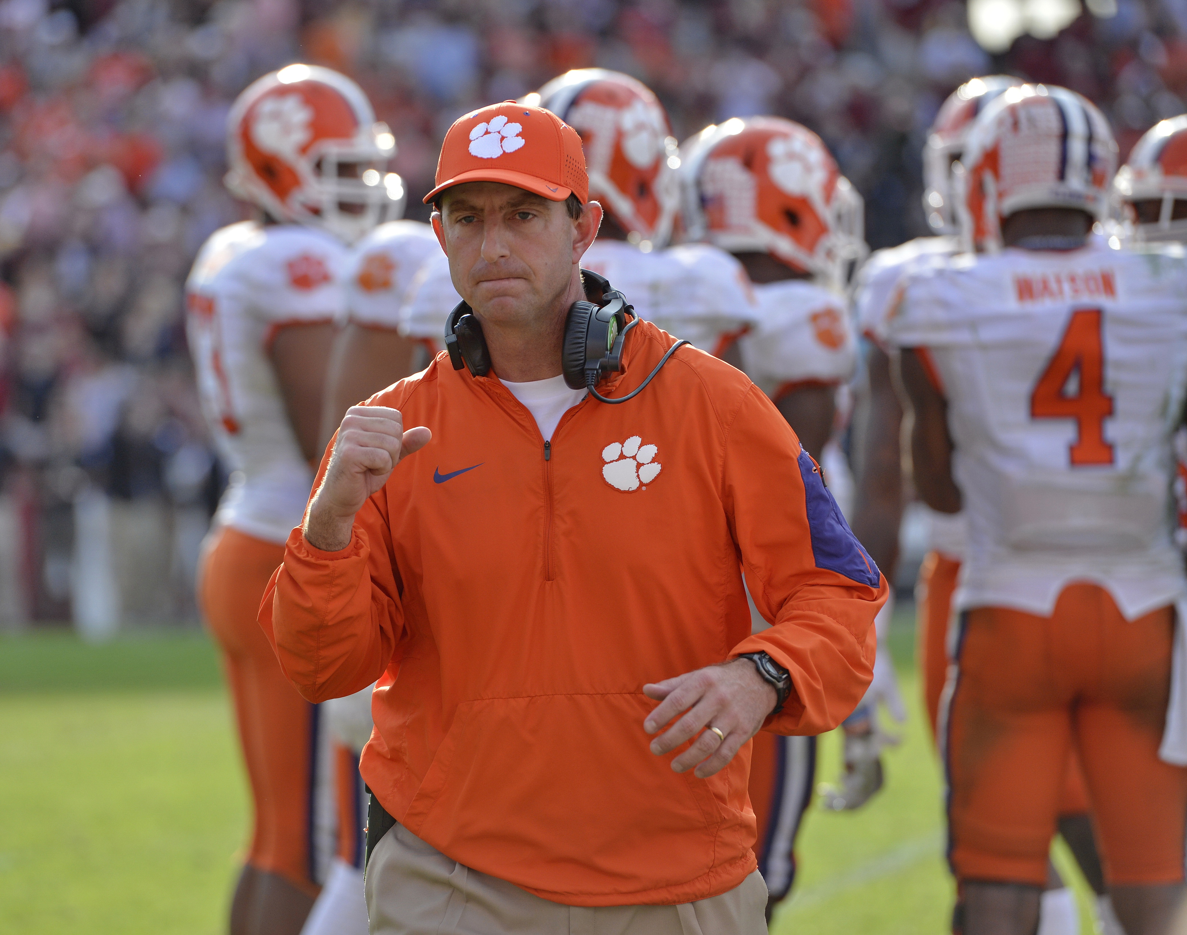 FILE - In this Nov. 28, 2015, file photo, Clemson head coach Dabo Swinney reacts in the closing minutes of an NCAA college football game against South Carolina in Columbia, S.C. Swinney grew up in near Birmingham, and like so many boys his age, dreamed of