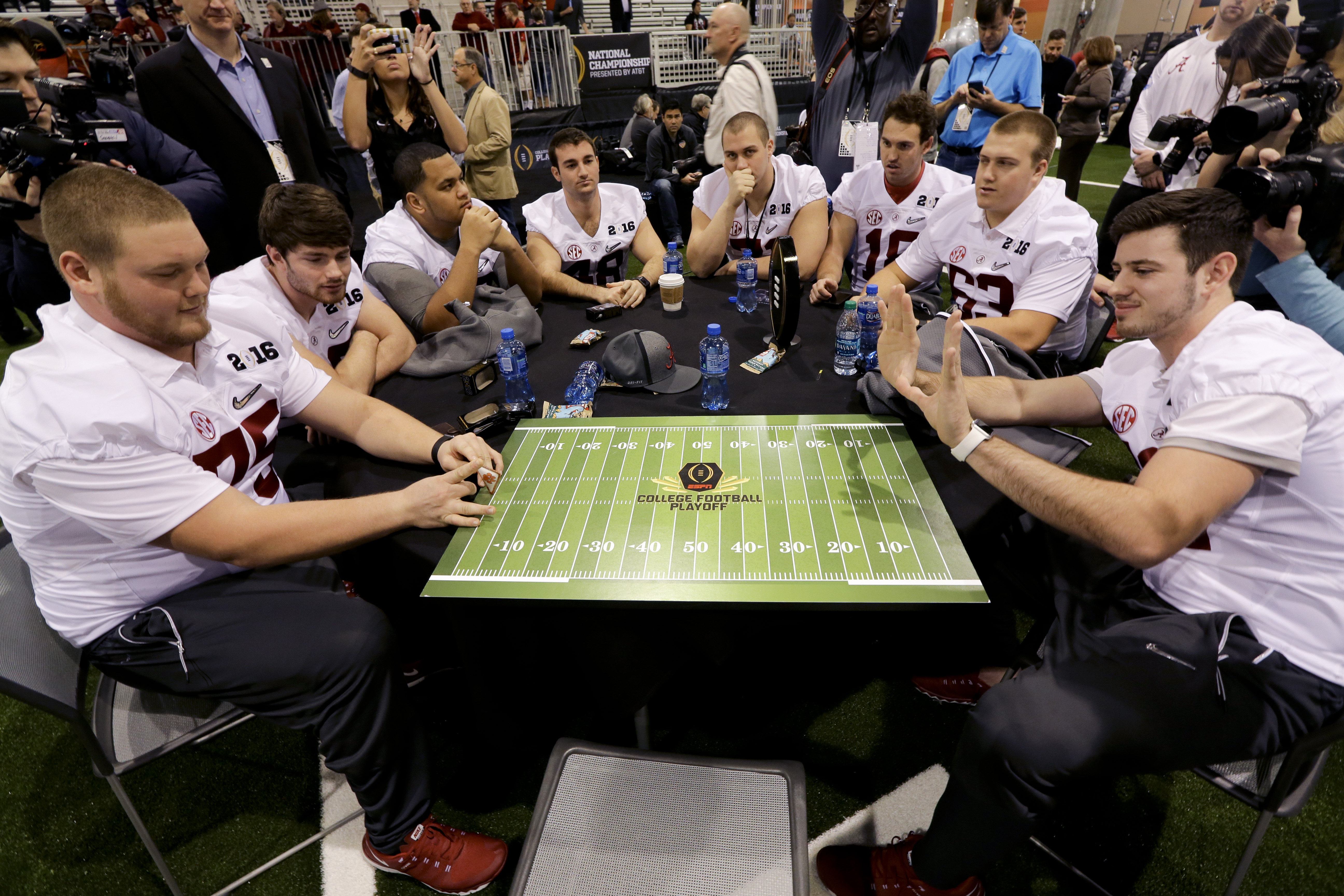 Alabama team members play a game during media day for the NCAA College Football Playoff National Championship in Phoenix, Saturday, Jan. 9, 2016. Alabama will face Clemson in Monday's game. (AP Photo/David J. Phillip)