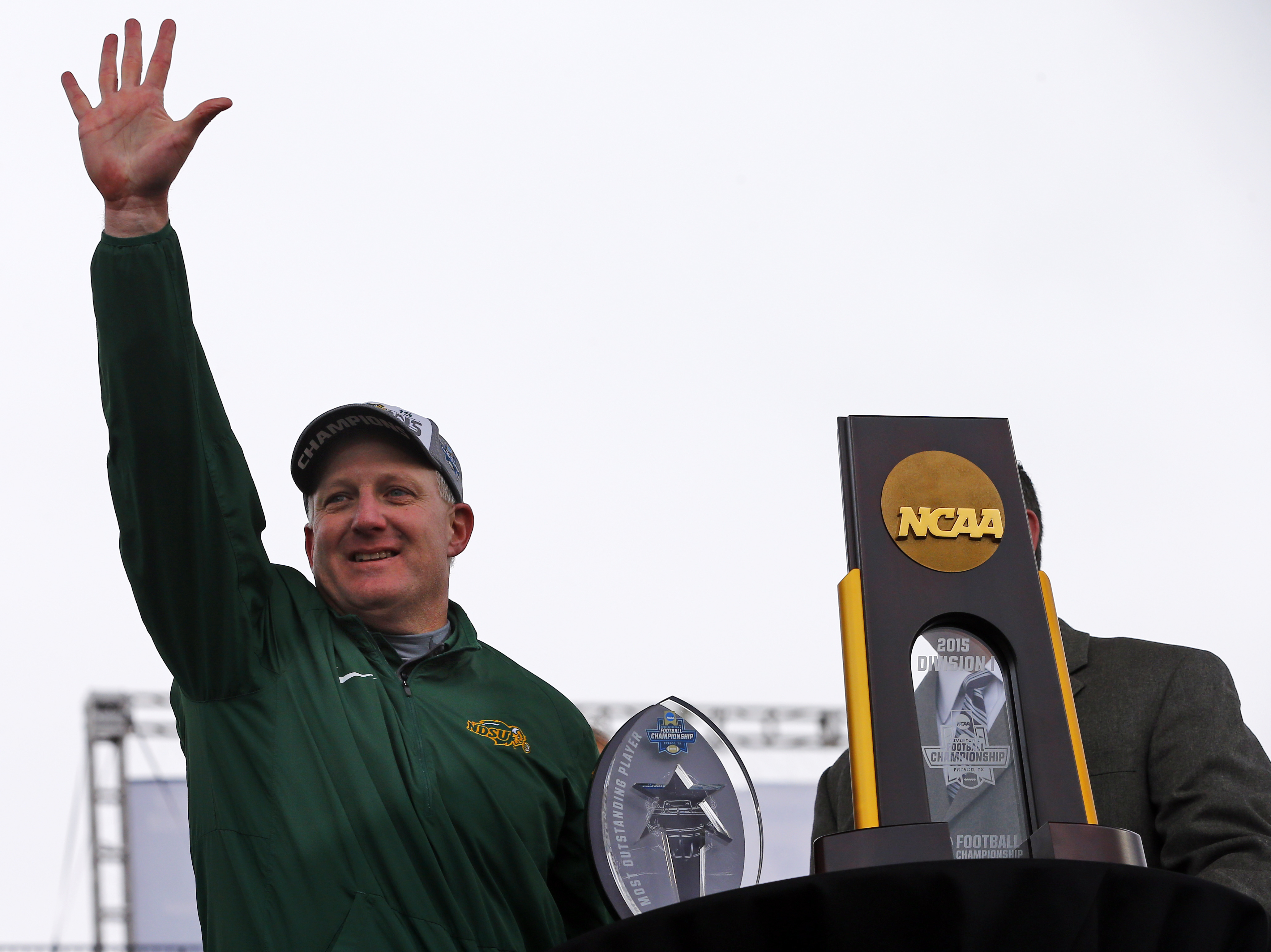 North Dakota State head coach Chris Klieman holds up five fingers after defeating Jacksonville State for their fifth consecutive championship after the FCS championship NCAA college football game, Saturday, Jan. 9, 2016, in Frisco, Texas.  North Dakota St