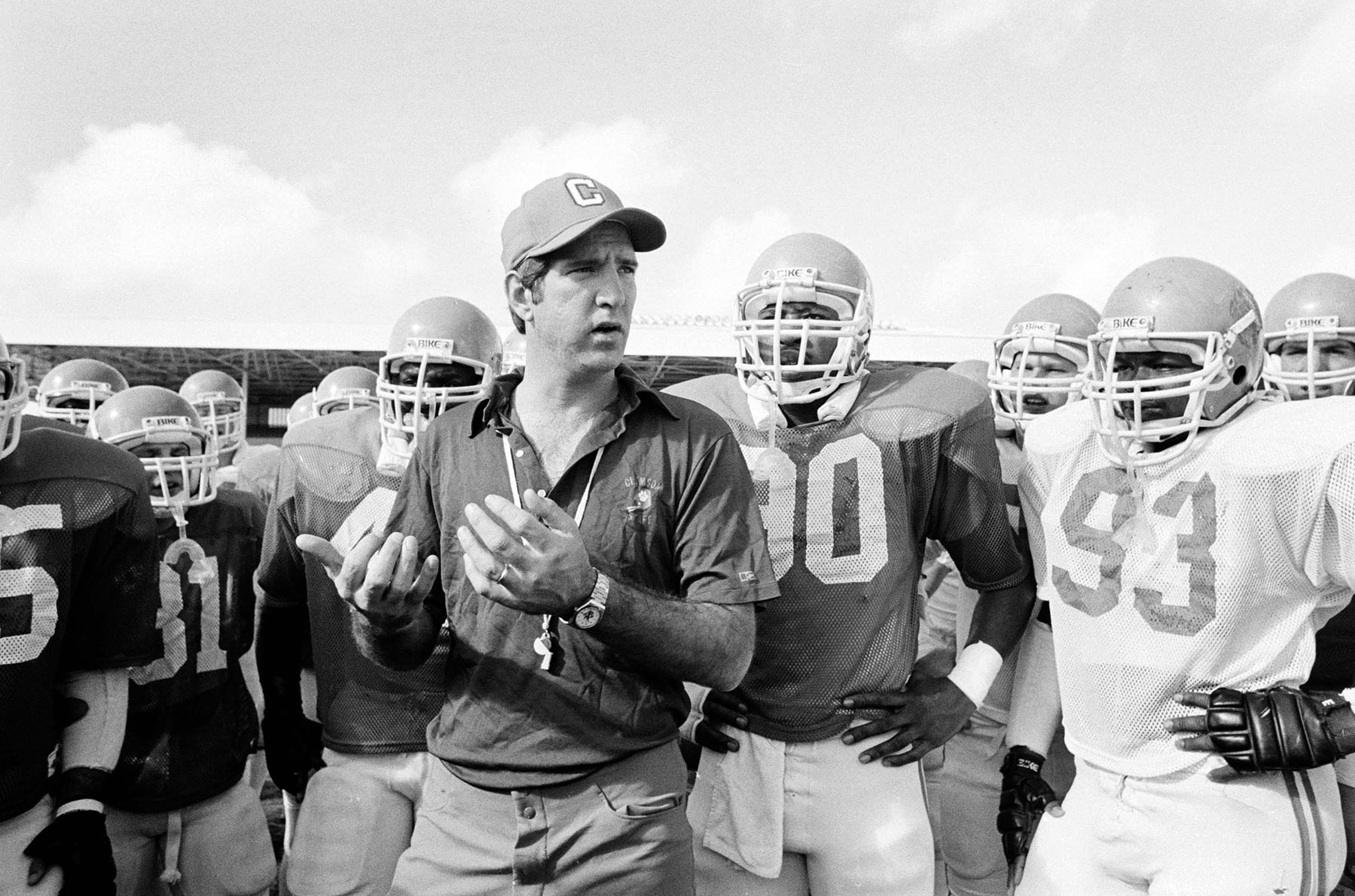 FILE - In this Jan. 1, 1982, file photo, Clemson football coach Danny Ford instructs his team at Tropical stadium in Miami as they warmed up for the NCAA college football Orange Bowl on the way to winning the national championship. Clemson defeated favori