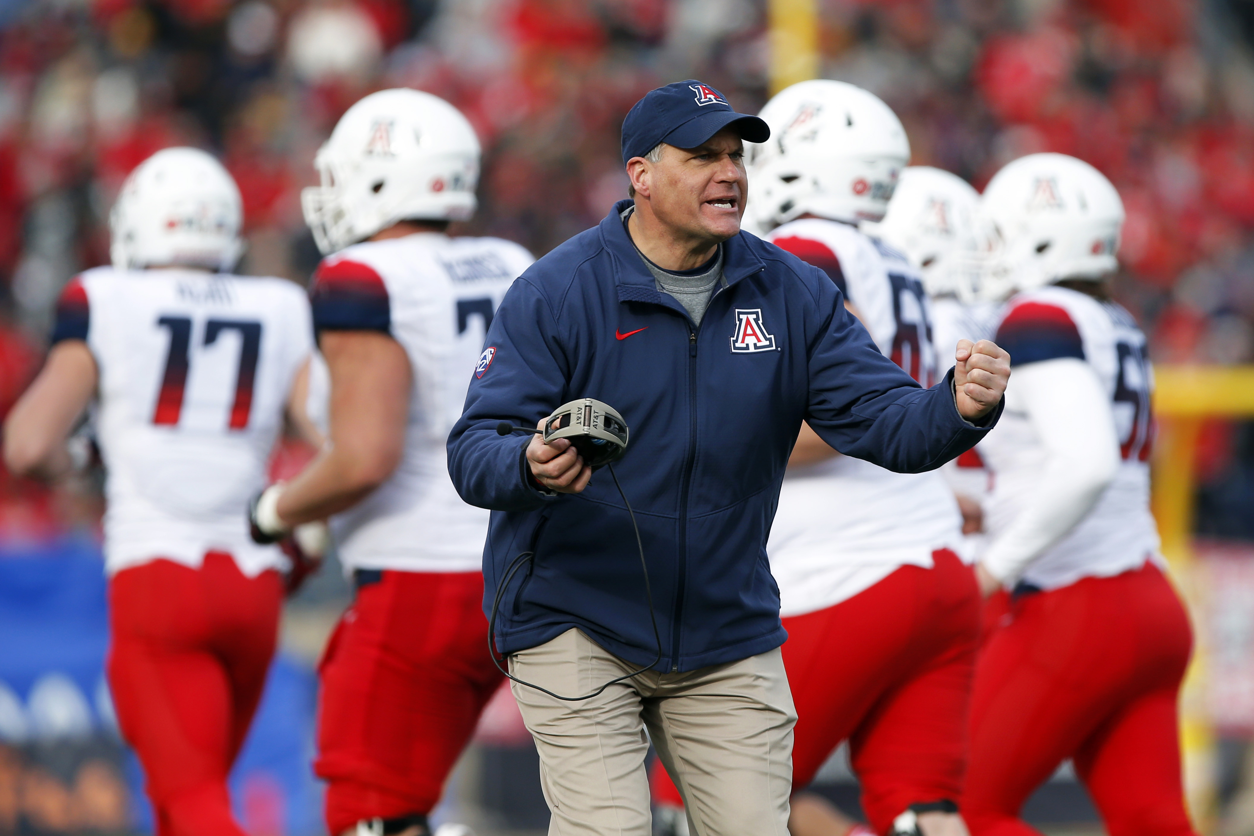 FILE - In this Dec. 19, 2015, file photo, Arizona head coach Rich Rodriguez encourages his players during a timeout in the second half of the New Mexico Bowl NCAA college football game against New Mexico in Albuquerque, N.M. Rodriguez hears it all the tim