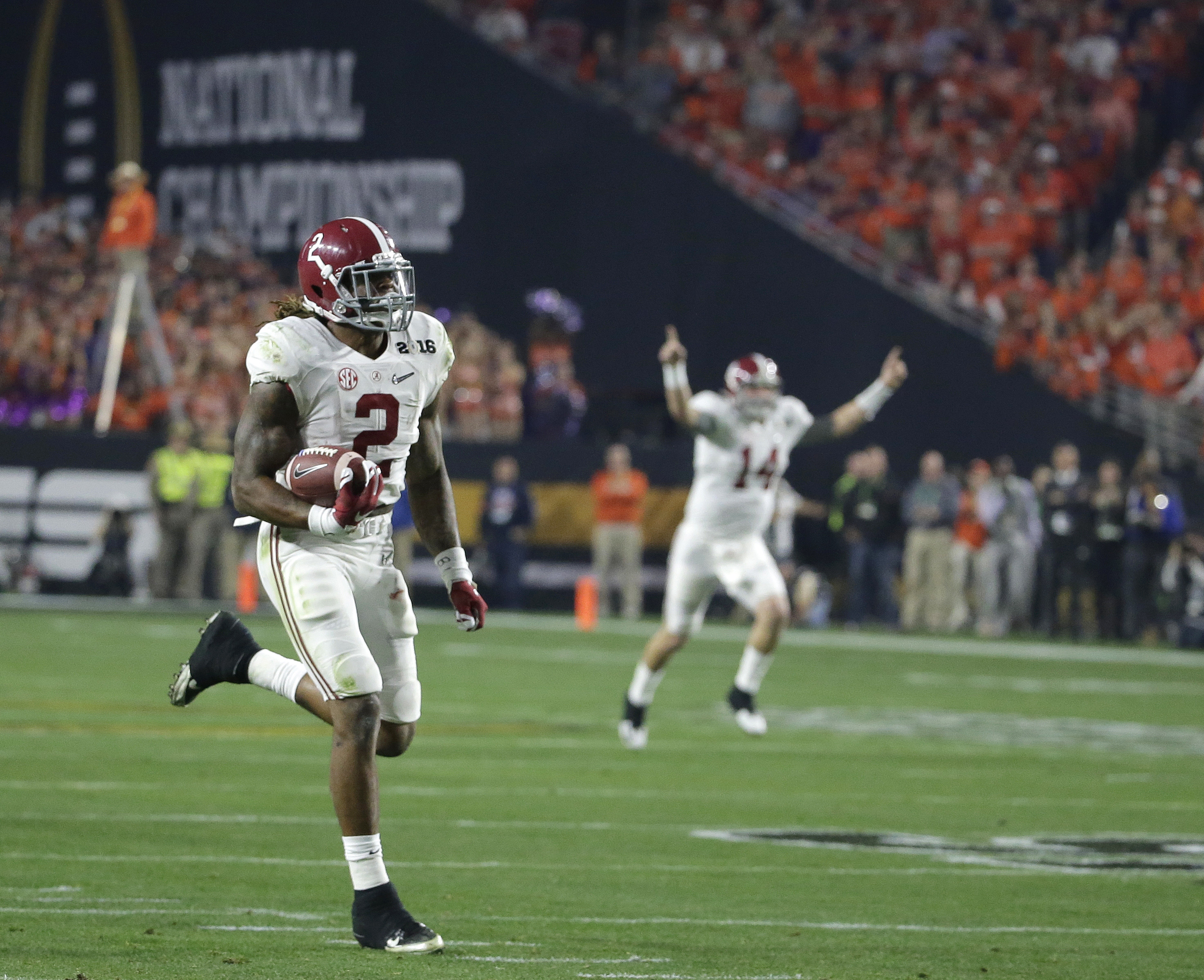Alabama's Jake Coker (14) reacts as Derrick Henry (2) runs to the end zone during the first half of the NCAA college football playoff championship game Monday, Jan. 11, 2016, in Glendale, Ariz. (AP Photo/Chris Carlson)