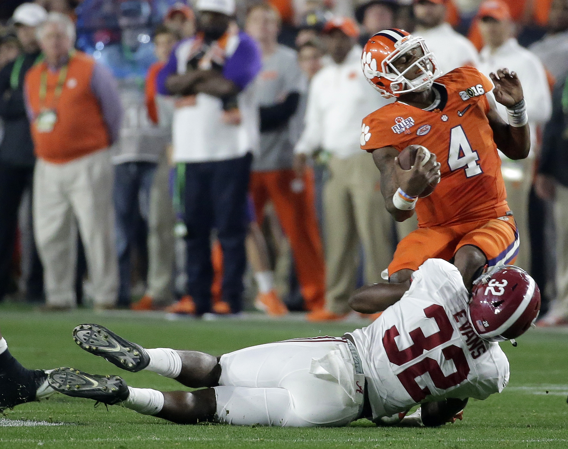 Alabama's Rashaan Evans (32) sacks Clemson quarterback Deshaun Watson during the second half of the NCAA college football playoff championship game Monday, Jan. 11, 2016, in Glendale, Ariz. (AP Photo/Chris Carlson)