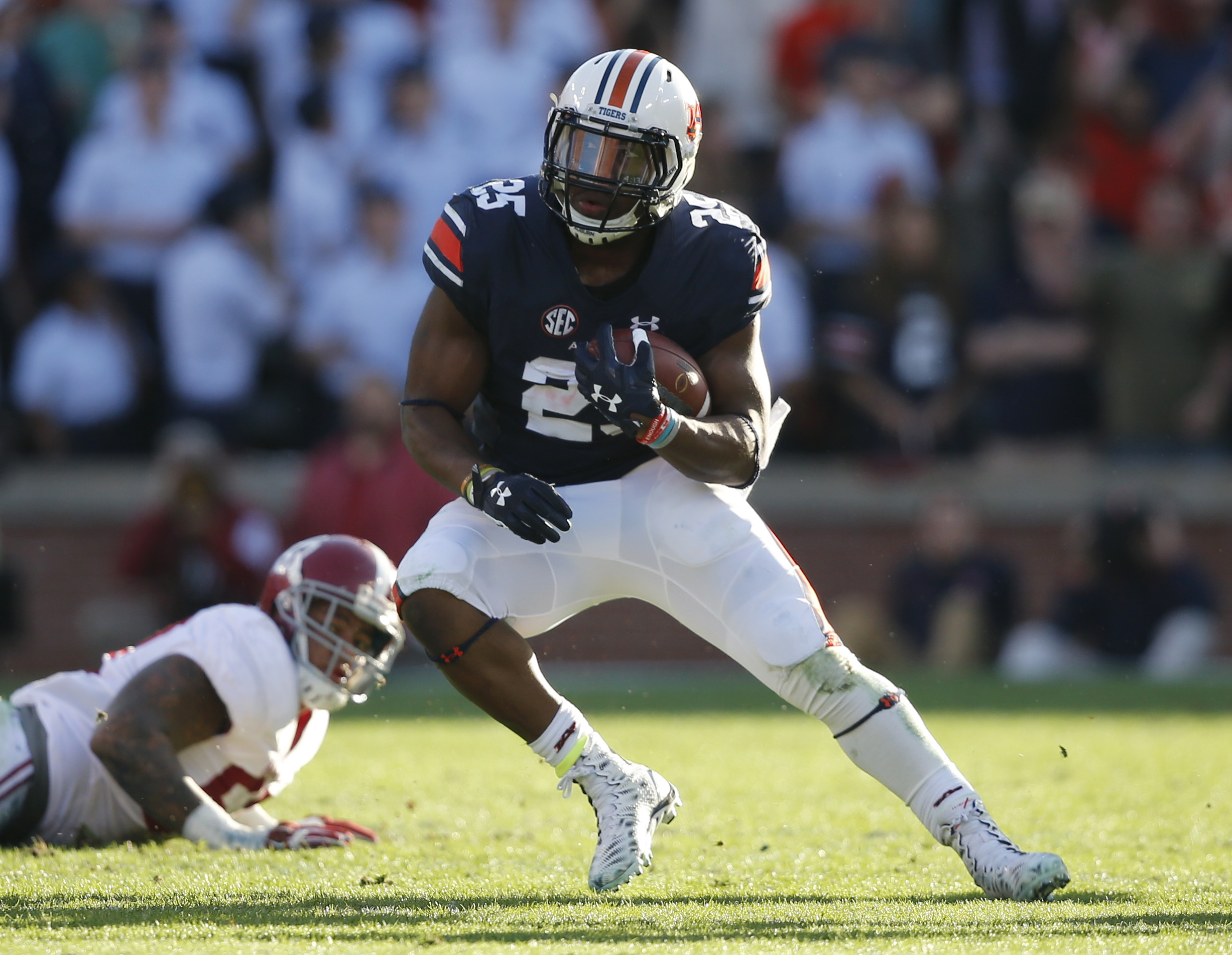Auburn running back Peyton Barber (25) runs the ball against Alabama defensive lineman D.J. Pettway (57) during an NCAA college football game, Saturday, Nov. 28, 2015, in Auburn, Ala. (AP Photo/Gerald Herbert)