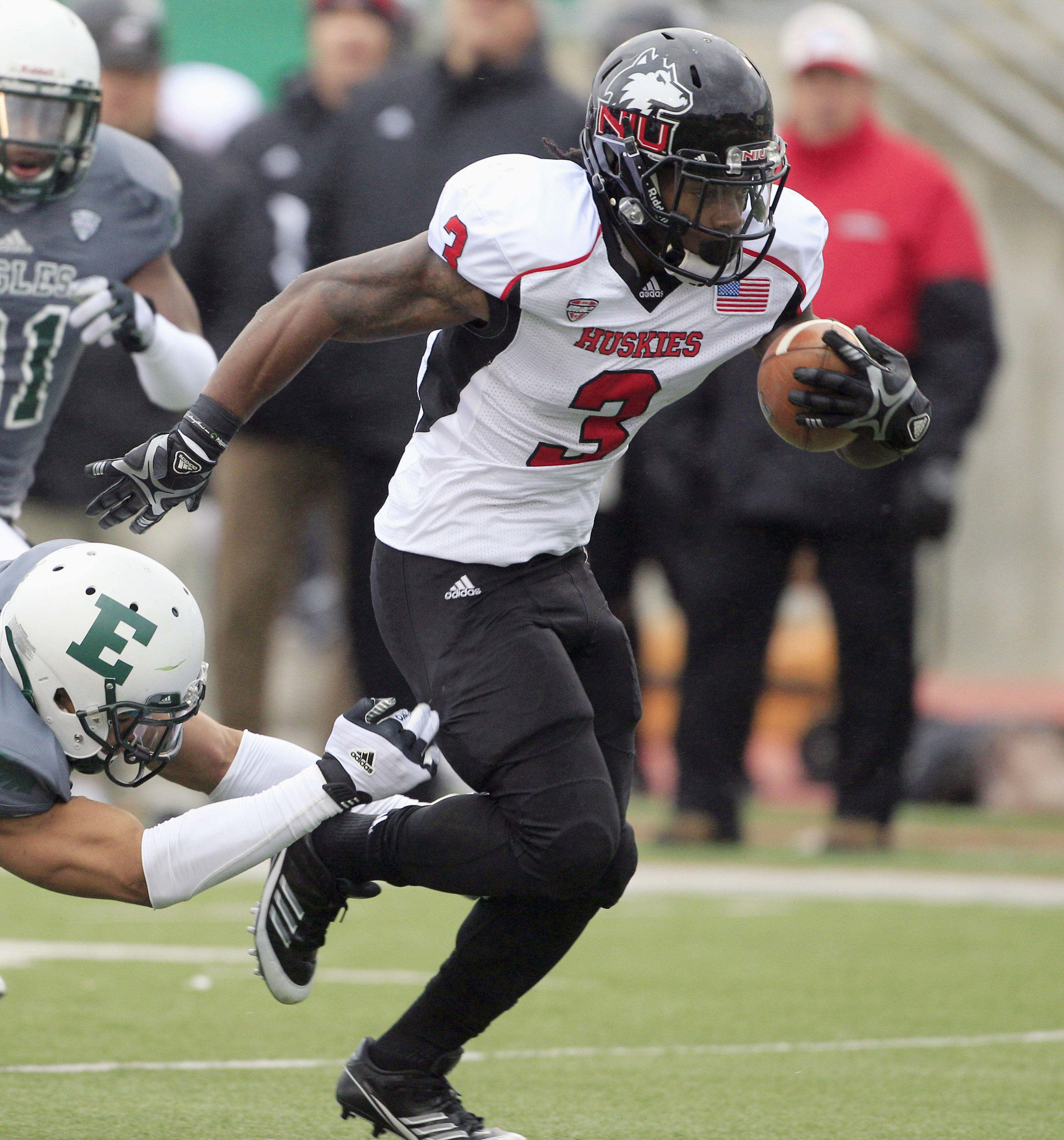 FILE - In this Nov. 23, 2012, file photo, Northern Illinois' Akeem Daniels (3) breaks a tackle during an NCAA college football game against Eastern Michigan in Ypsilanti, Mich. The former NIU running back filed a lawsuit in Chicago, Wednesday, Jan. 27, 20
