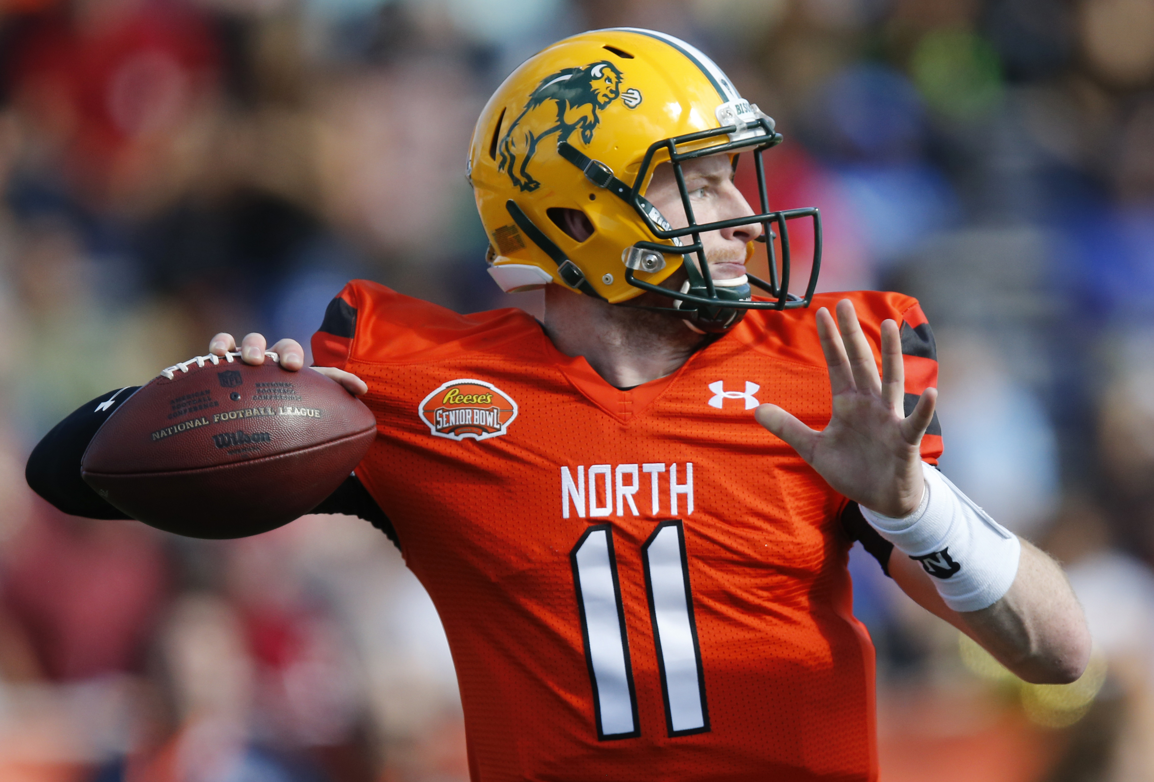 North Dakota State quarterback Carson Wentz, of the North Team, throws a pass during the Senior Bowl NCAA college football game, Saturday, Jan. 30, 2016, at LaddPeebles Stadium, in Mobile, Ala. (AP Photo/Brynn Anderson)