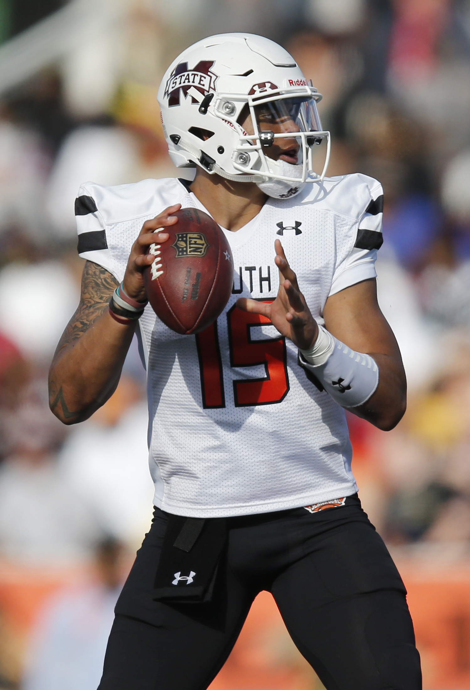 South Team quarterback Dak Prescott, of Mississippi State, looks to pass during first half of the Senior Bowl NCAA college football game, Saturday, Jan. 30, 2016, at LaddPeebles Stadium, in Mobile, Ala. (AP Photo/Brynn Anderson)