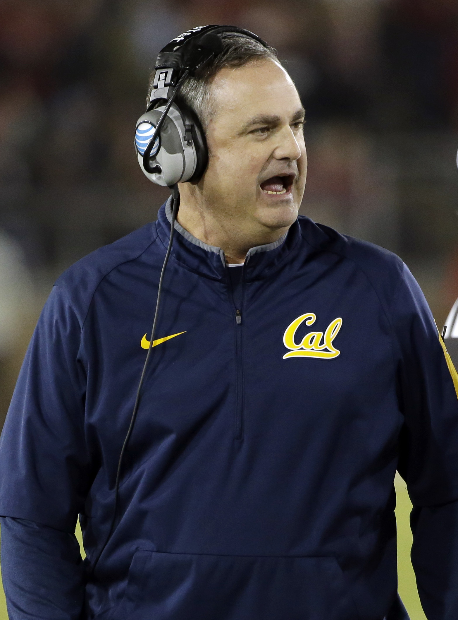 California head coach Sonny Dykes yells out instructions during the first half of an NCAA college football game against Stanford  Saturday, Nov. 21, 2015, in Stanford, Calif. (AP Photo/Marcio Jose Sanchez)