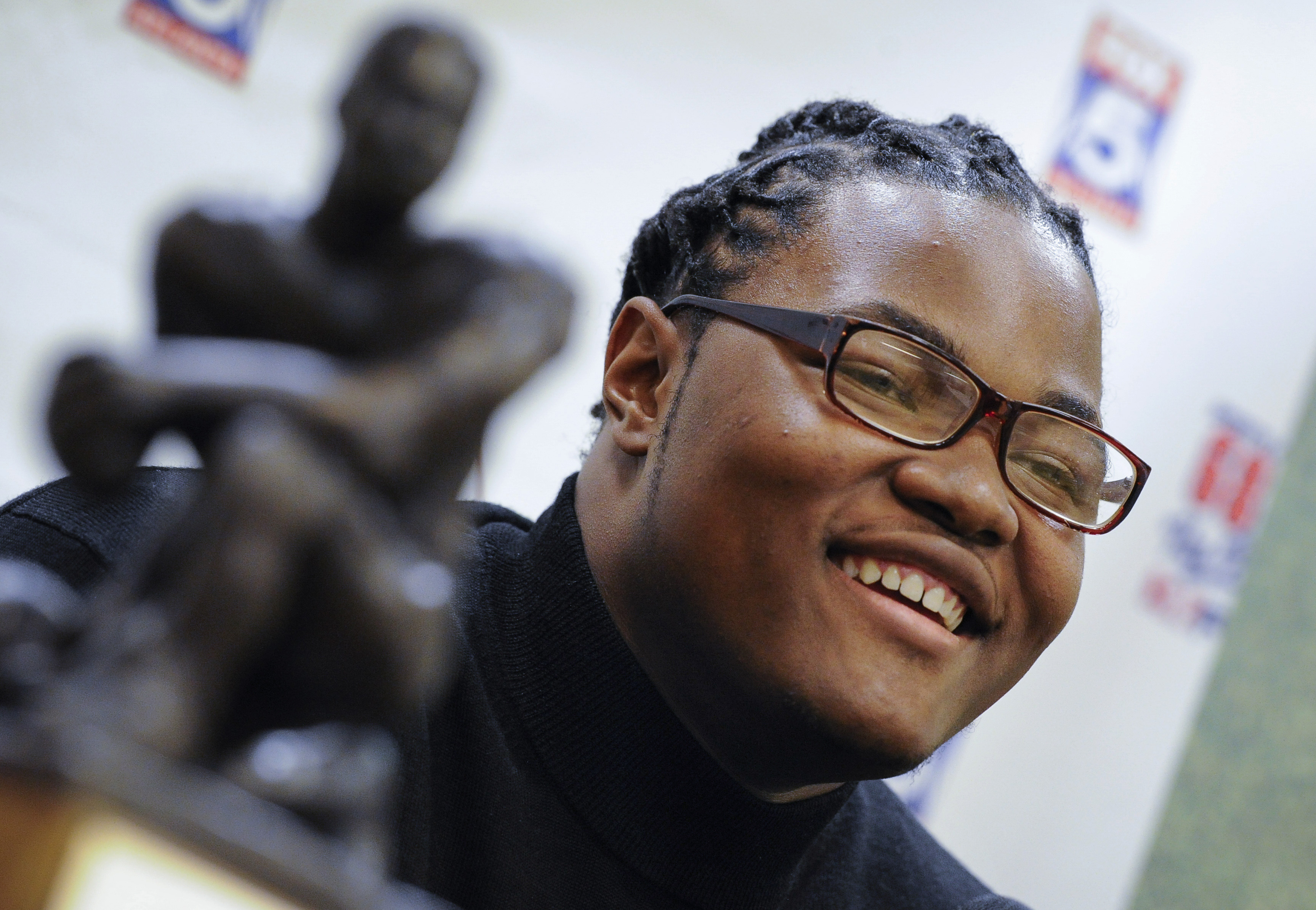 FILE - In this Thursday, Jan. 28, 2016, file photo, defensive lineman Rashan Gary, of Paramus, N.J., talks to reporters at the Touchdown Club of Atlanta, in Atlanta. Gary, a defensive tackle from Paramus Catholic High School, is the No. 1 recruit in the c