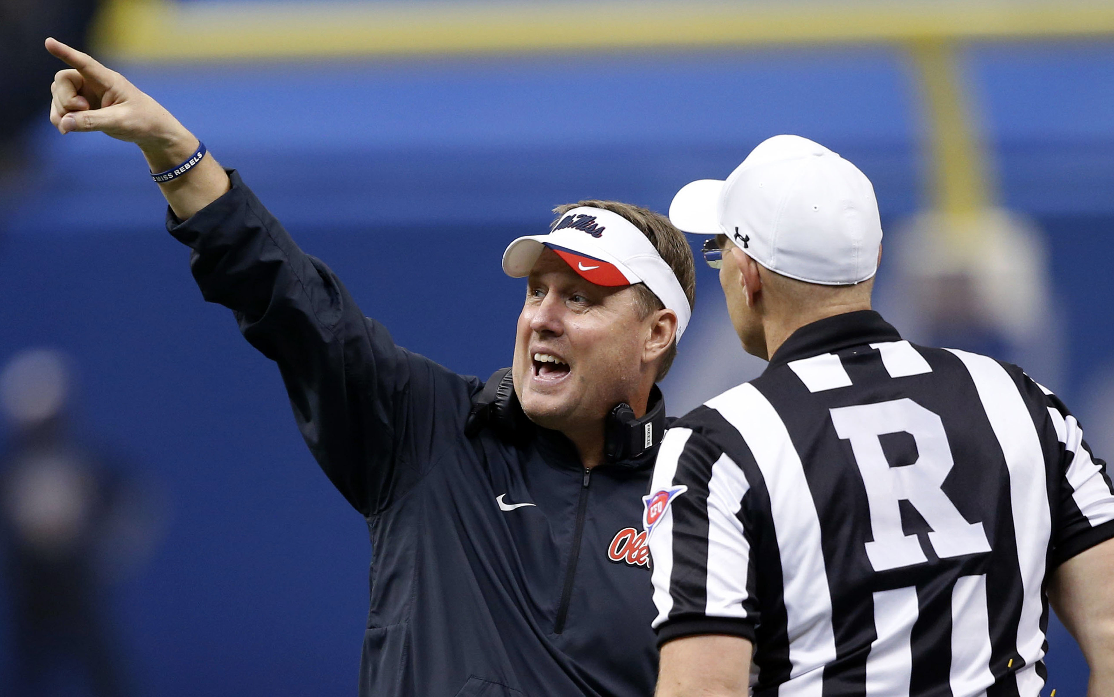 FILE - In this Jan. 1, 2016, file photo, Mississippi head coach Hugh Freeze, left, challenges an official in the first half of the Sugar Bowl college football game against Oklahoma State in New Orleans. Mississippi, led by fifth-year head coach Freeze, ha