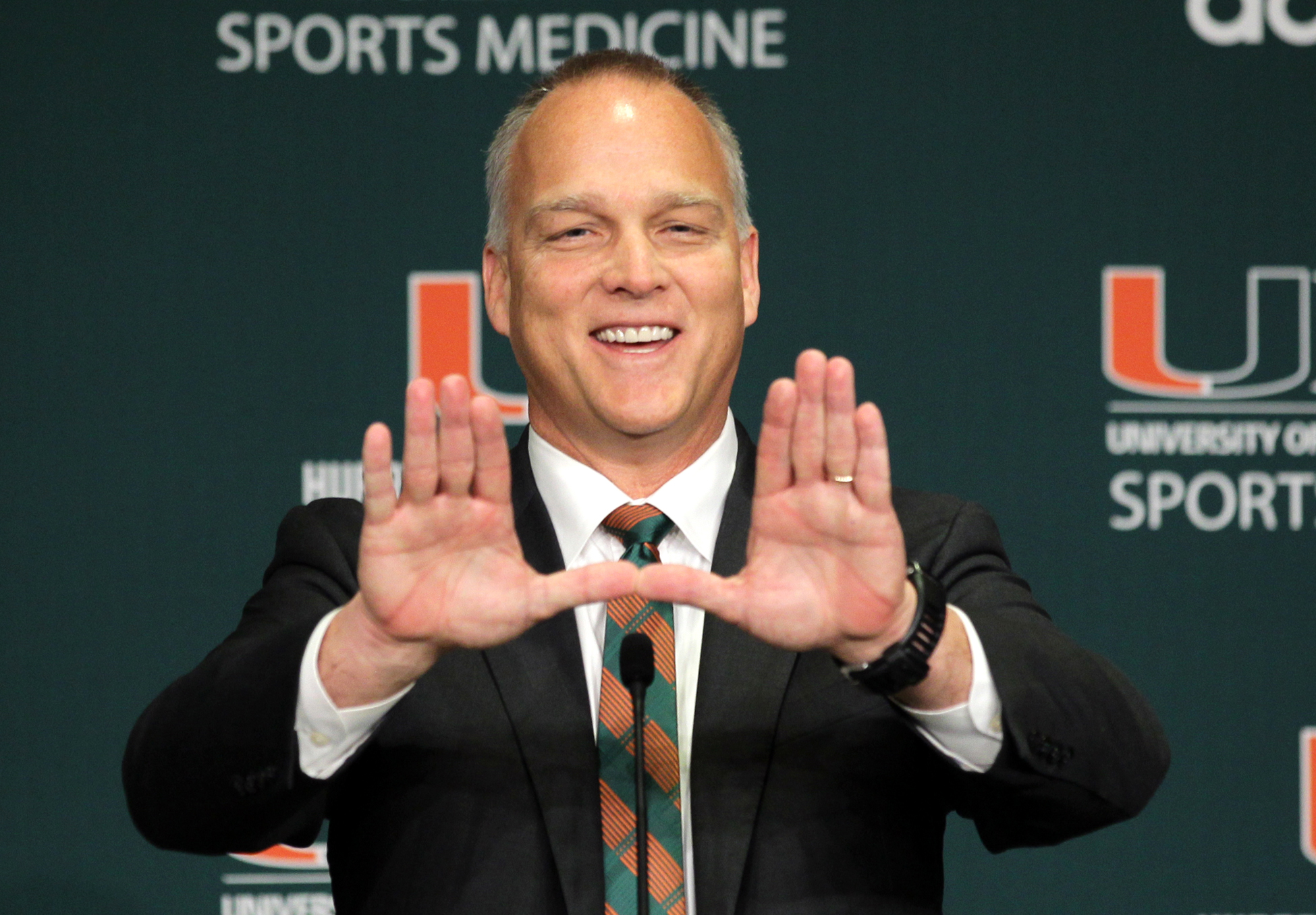 FILE - In this Dec. 4, 2015, file photo, Miami's new football coach Mark Richt gestures after being introduced during an NCAA college football news conference in Coral Gables, Fla. Richt's first signing day as coach of the Miami Hurricanes has finally arr