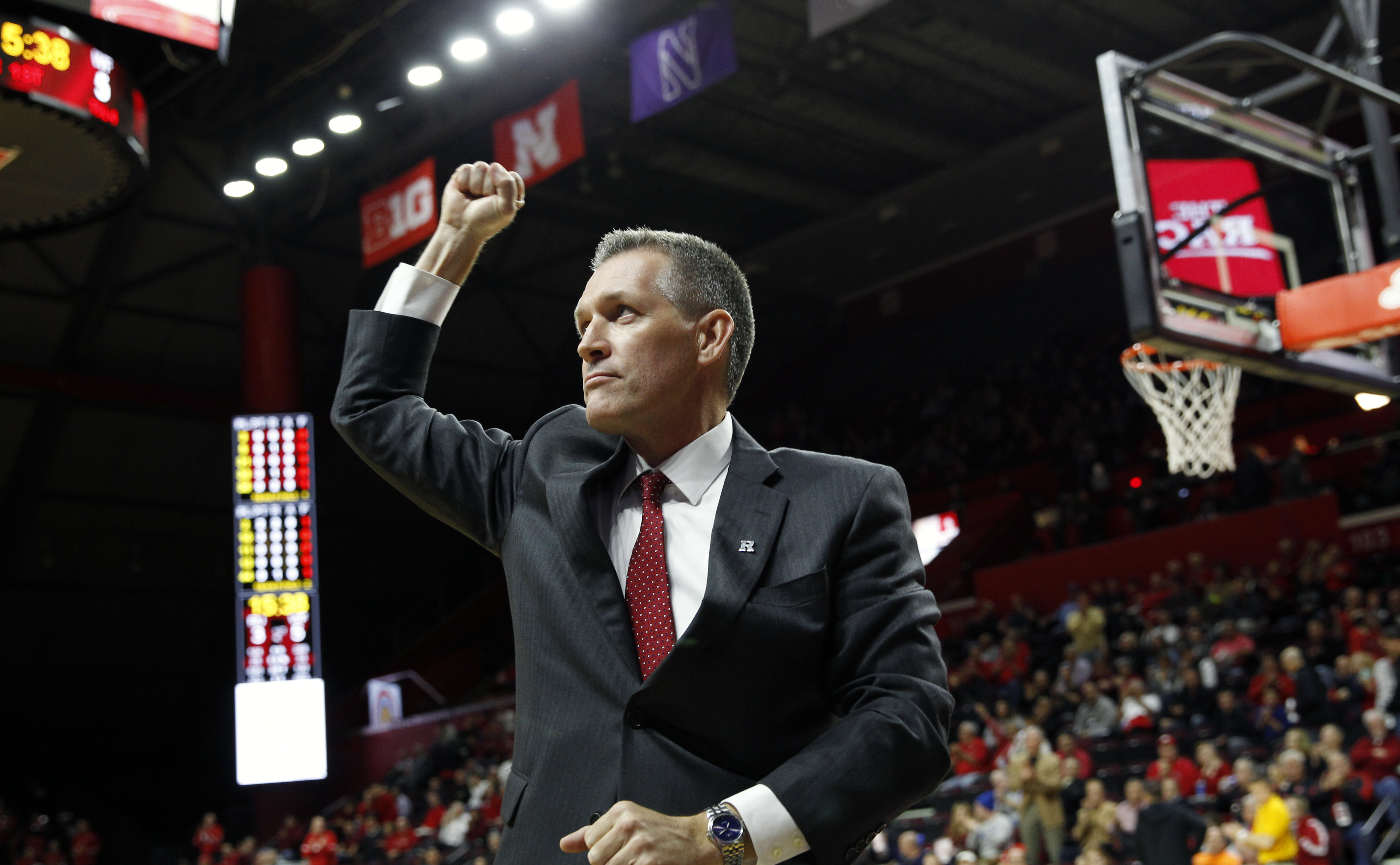 FILE - In this Nov, 30, 2015, file photo, Rutgers new athletic director Patrick Hobbs reacts to the crowd as he stands on the court during an NCAA college basketball game against Wake Forest in Piscataway, N.J. Hobbs is inheriting a program awash in red i