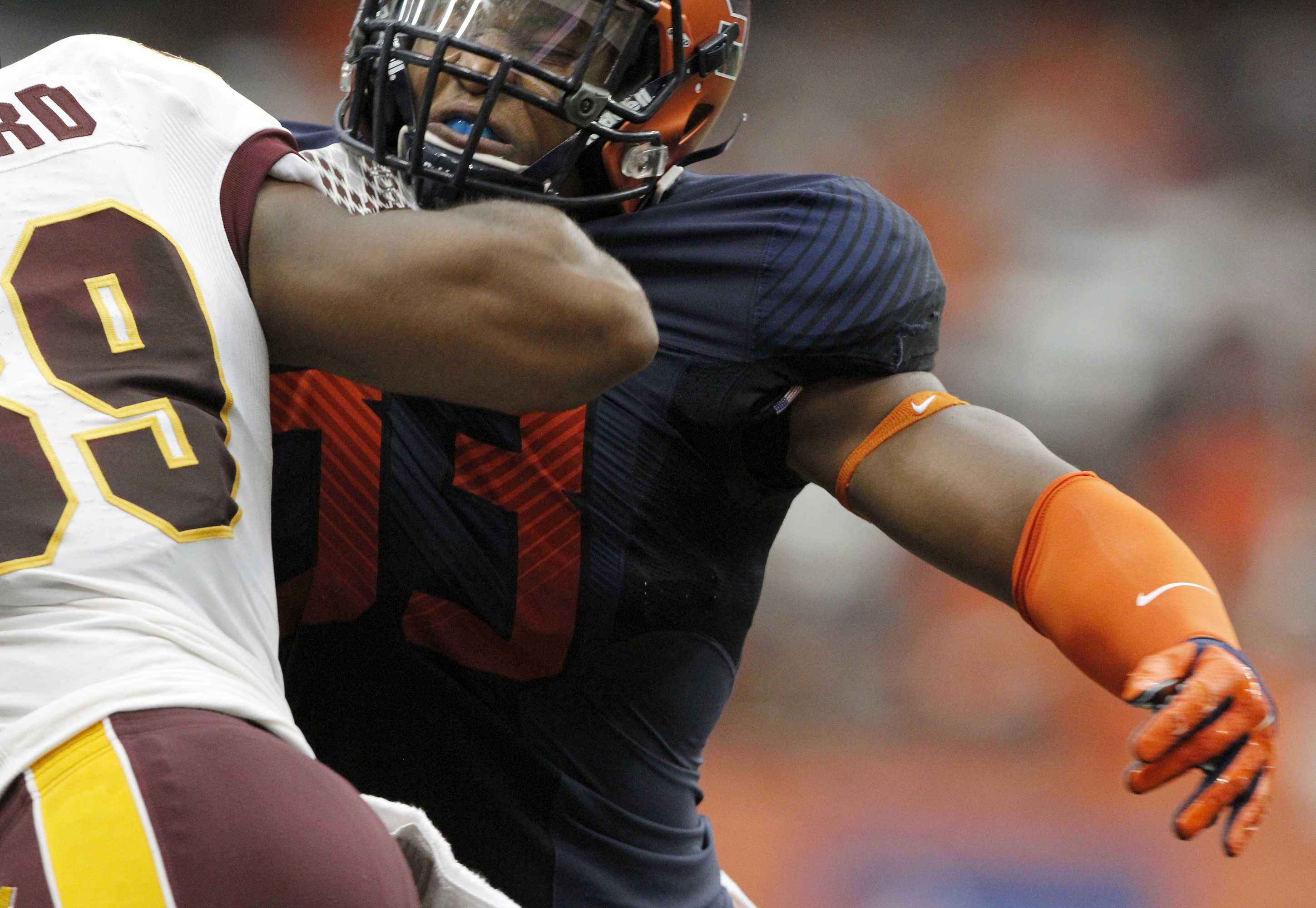 Syracuse's Qaadir Sheppard (right) tries to get past Central Michigan's Ben McCord (left) in the first quarter of an NCAA college football game in Syracuse, N.Y., Saturday, Sept. 19, 2015. (AP Photo/Nick Lisi)