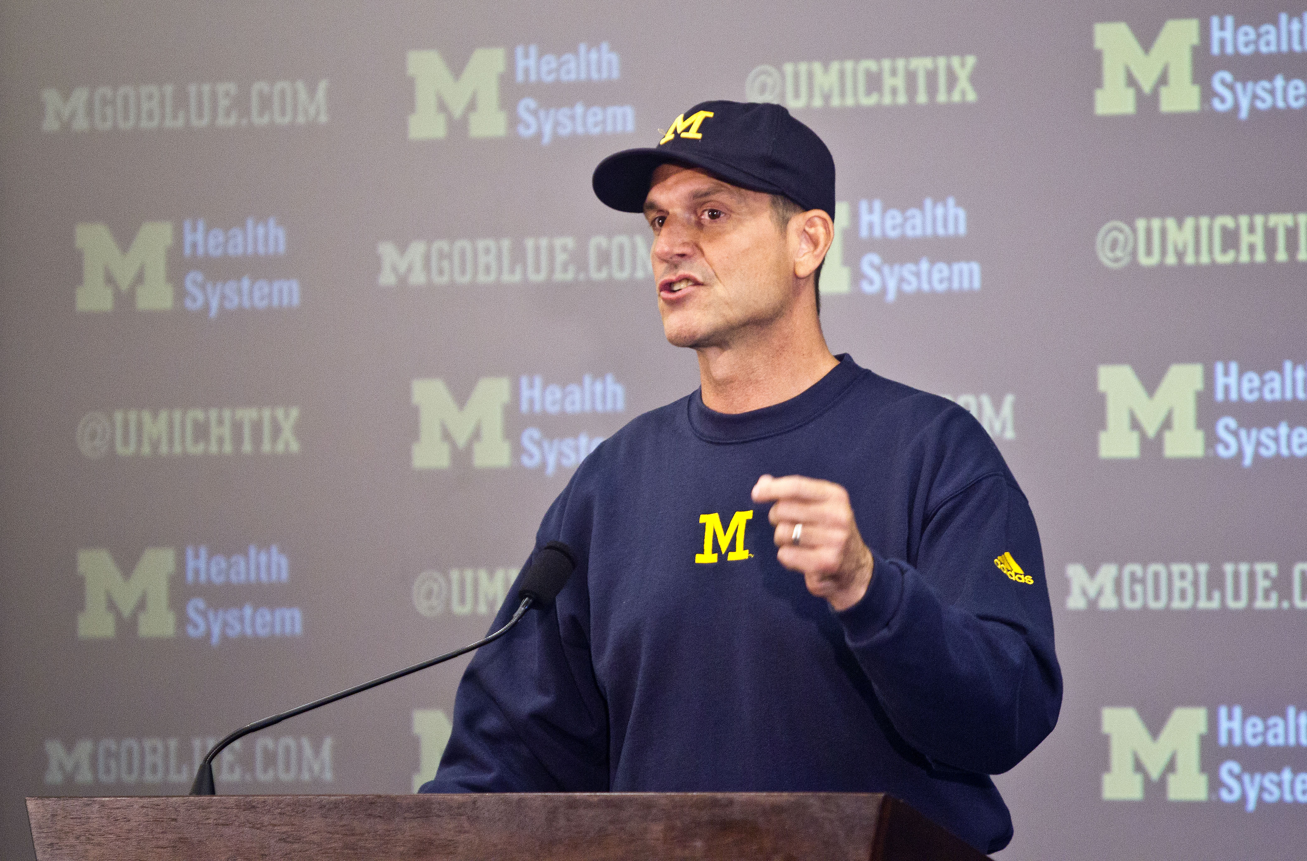 FILE - In this Aug. 6, 2015, file photo, Michigan head coach Jim Harbaugh speaks at a press conference during the NCAA college football team's annual media day in Ann Arbor, Mich. Jim Harbaugh has come up with another way to get in the spotlight. Michigan