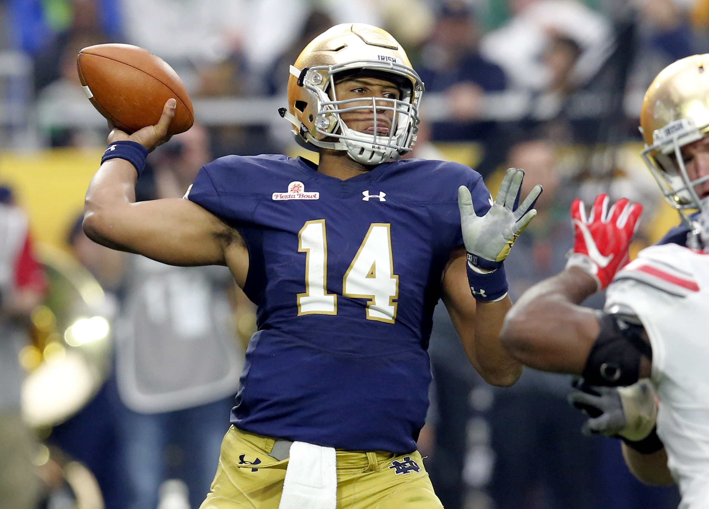 FILE - In this Jan. 1, 2016, file photo, Notre Dame quarterback DeShone Kizer (14) throws against Ohio State during the first half of the Fiesta Bowl NCAA college football game in Glendale, Ariz. Kizer saved Notre Dame's season after Malik Zaire broke his