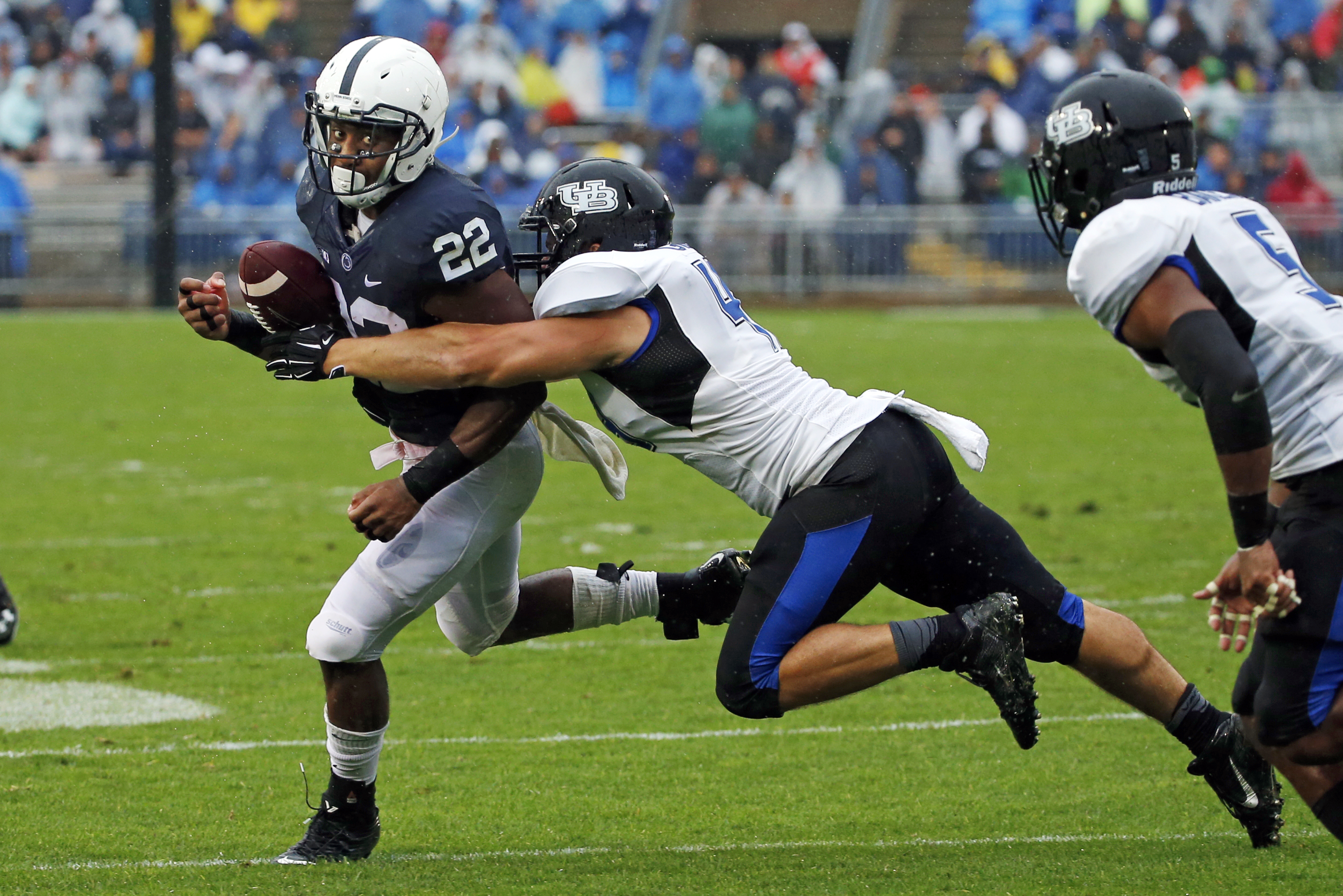 Penn State running back Akeel Lynch (22) tries to turn the corner on Buffalo defensive end Solomon Jackson (41) during the first half of an NCAA college football game in State College, Pa, Saturday, Sept. 12, 2015. (AP Photo/Gene J. Puskar)
