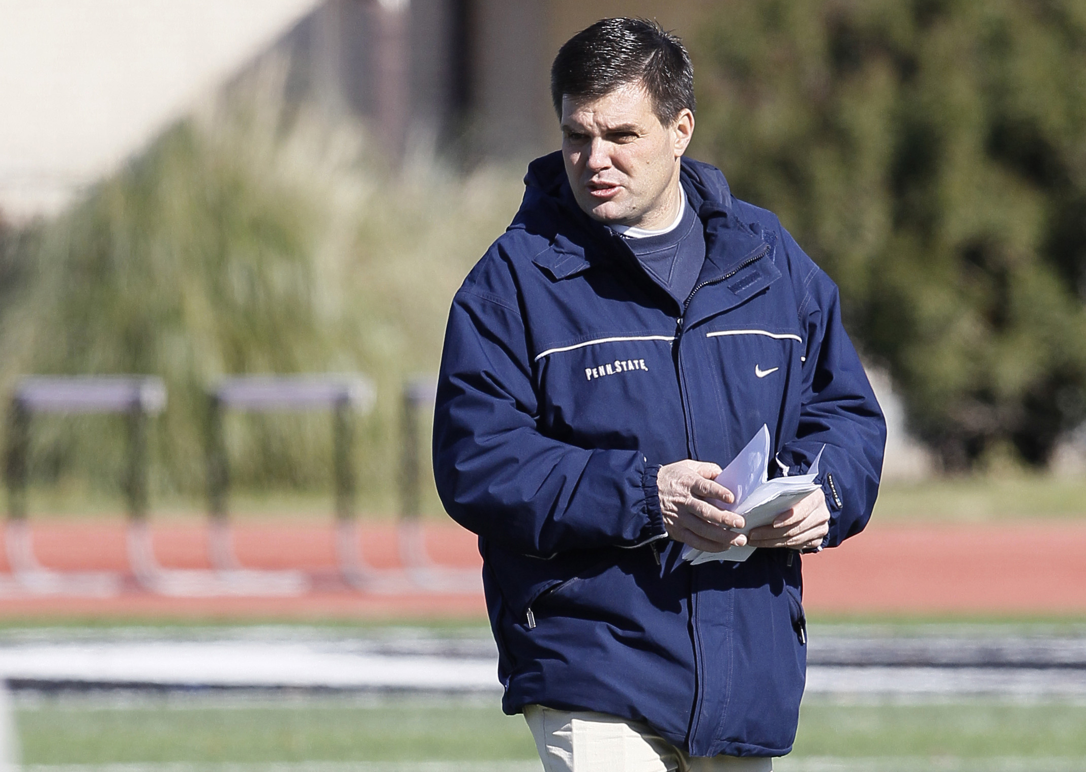 FILE - In this Dec. 27, 2011, file photo, Penn State assistant coach Jay Paterno, son of Joe Paterno, watches during NCAA college football game practice at Bishop Lynch High School in Dallas. A federal lawsuit filed against Penn State by  son of late foot