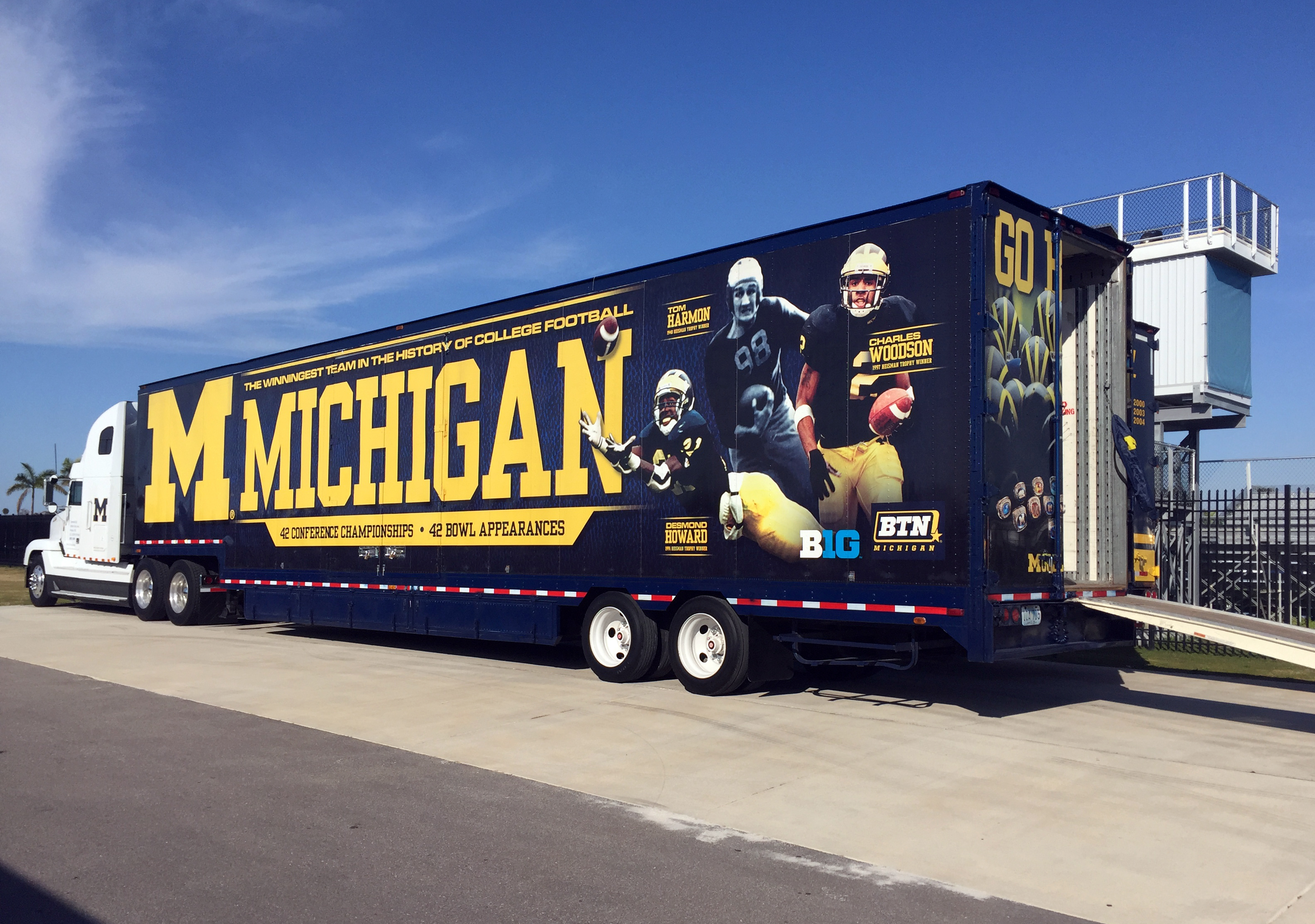 A University of Michigan equipment truck is parked next to a practice field Tuesday, March 1, 2016, at IMG Academy in Bradenton, Fla. The Wolverines are spending a week at the boarding school for elite athletes, holding spring NCAA college football practi