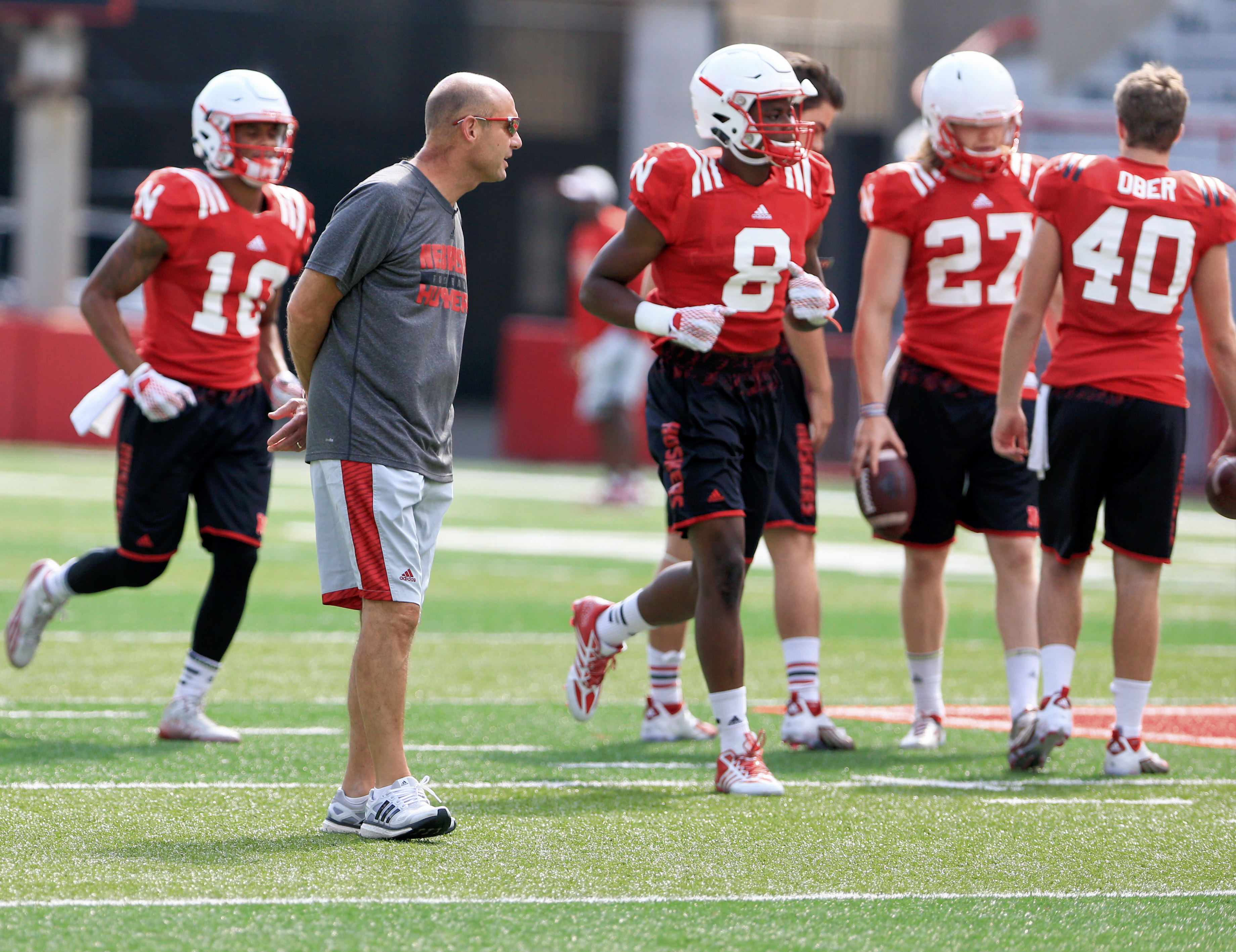 FILE - In this Tuesday, Sept. 1, 2015 file photo, Nebraska head coach Mike Riley follows NCAA college football practice in Lincoln, Neb. Even before Ivy League coaches voted to eliminate full-contact practices from the regular season, teams all across col