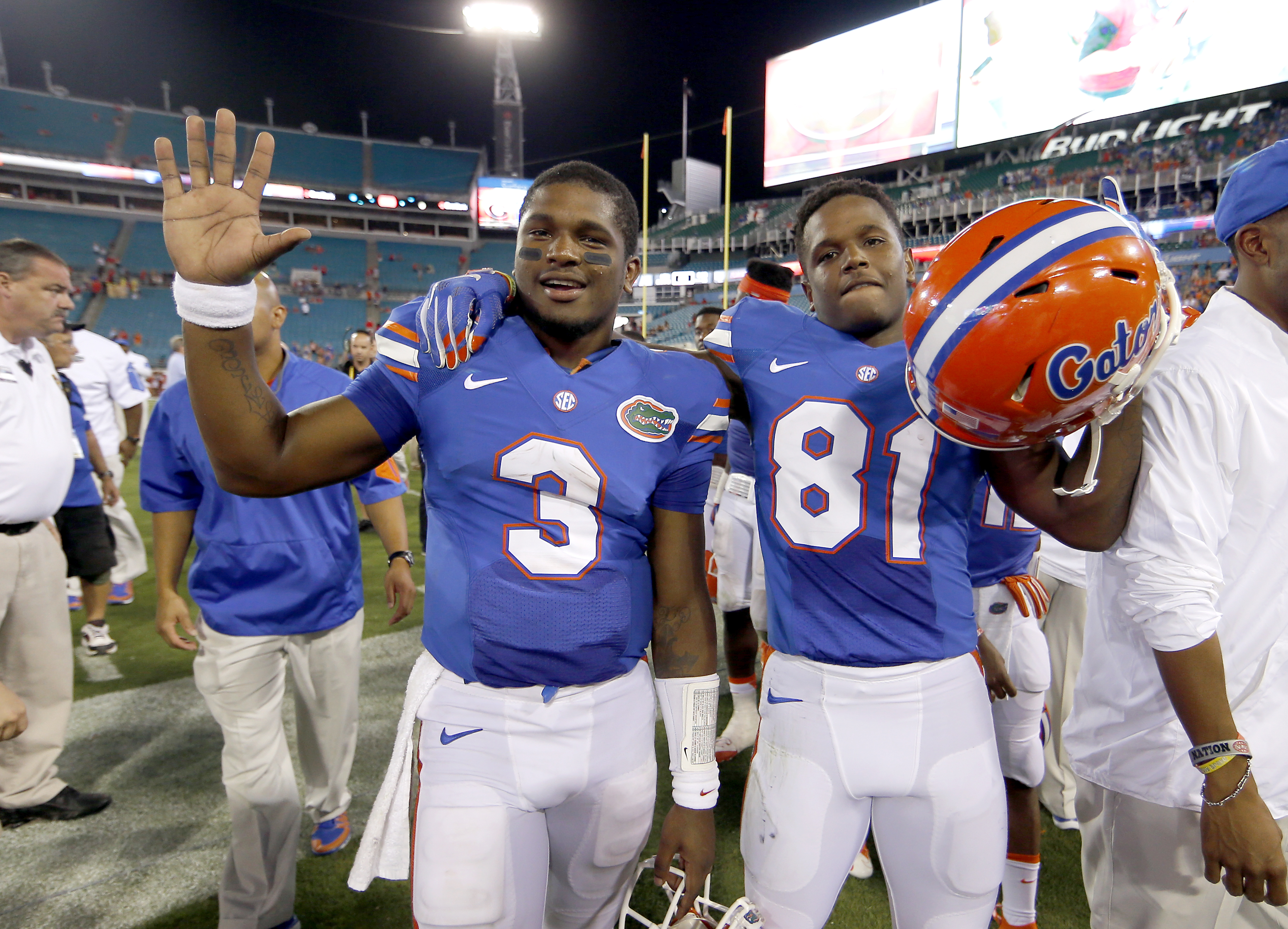 FILE - In this Oct. 31, 2015, file photo, Florida quarterback Treon Harris (3) and wide receiver Antonio Callaway (81) walk off the field together following an NCAA college football game against Georgia in Jacksonville, Fla. Florida coach Jim McElwain sai