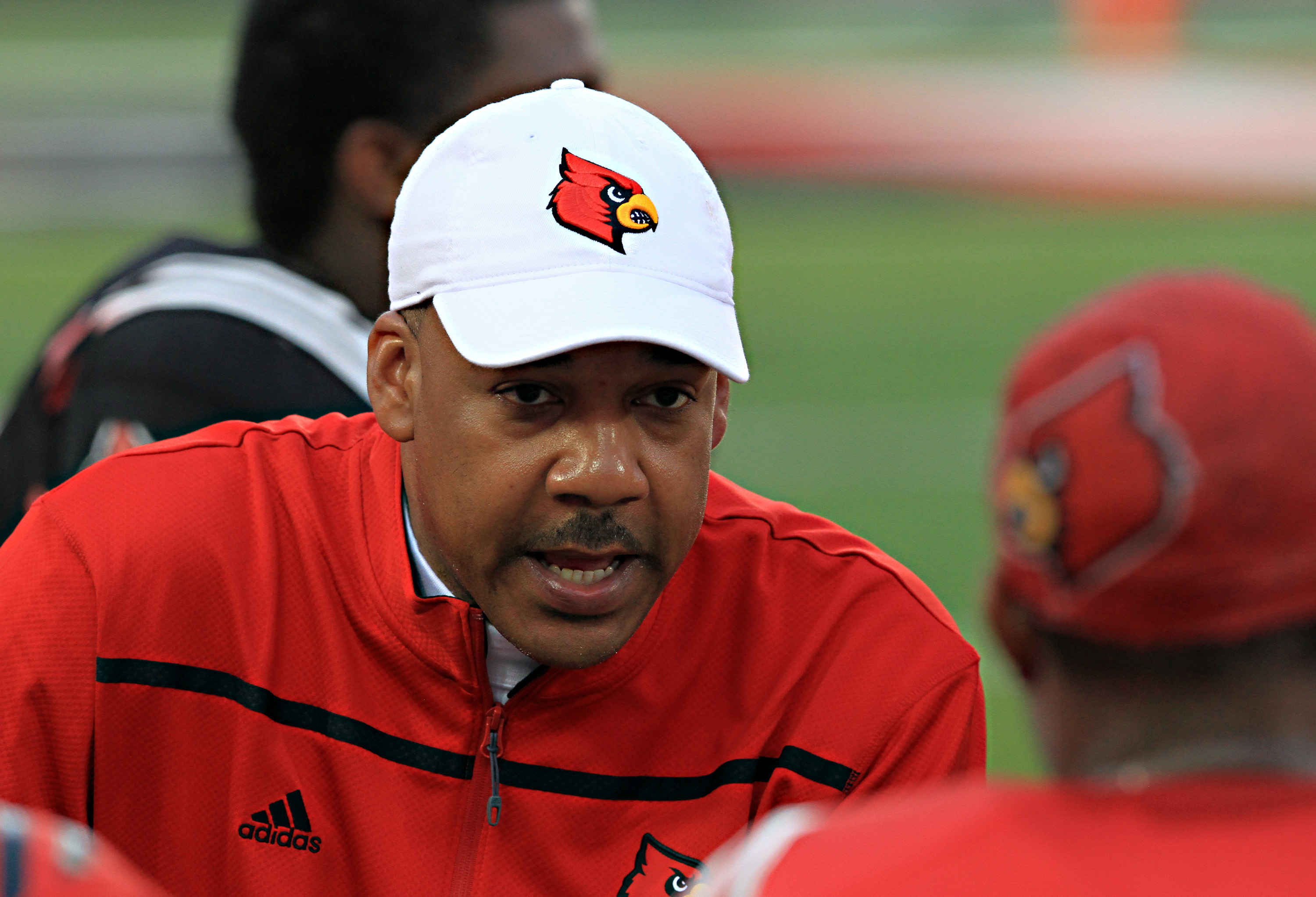 FILE - In this April 17, 2015, file photo, Louisville offensive coordinator Garrick McGee talks to the offensive unit on the sidelines in the annual spring NCAA college football scrimmage at Cardinal Stadium in Louisville, Ky. Garrick McGee is leaving Lou