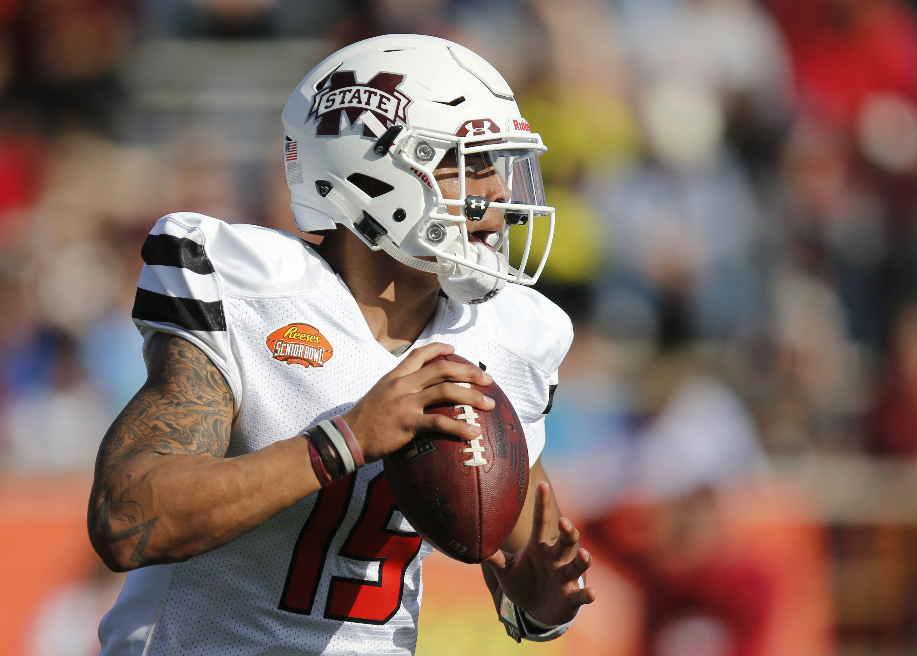 FILE - In this Jan. 30, 2016 file photo, South Team quarterback Dak Prescott, of Mississippi State, looks to pass during the first half of the Senior Bowl NCAA college football game, in Mobile, Ala. Prescott and about 15 other Mississippi State players wo