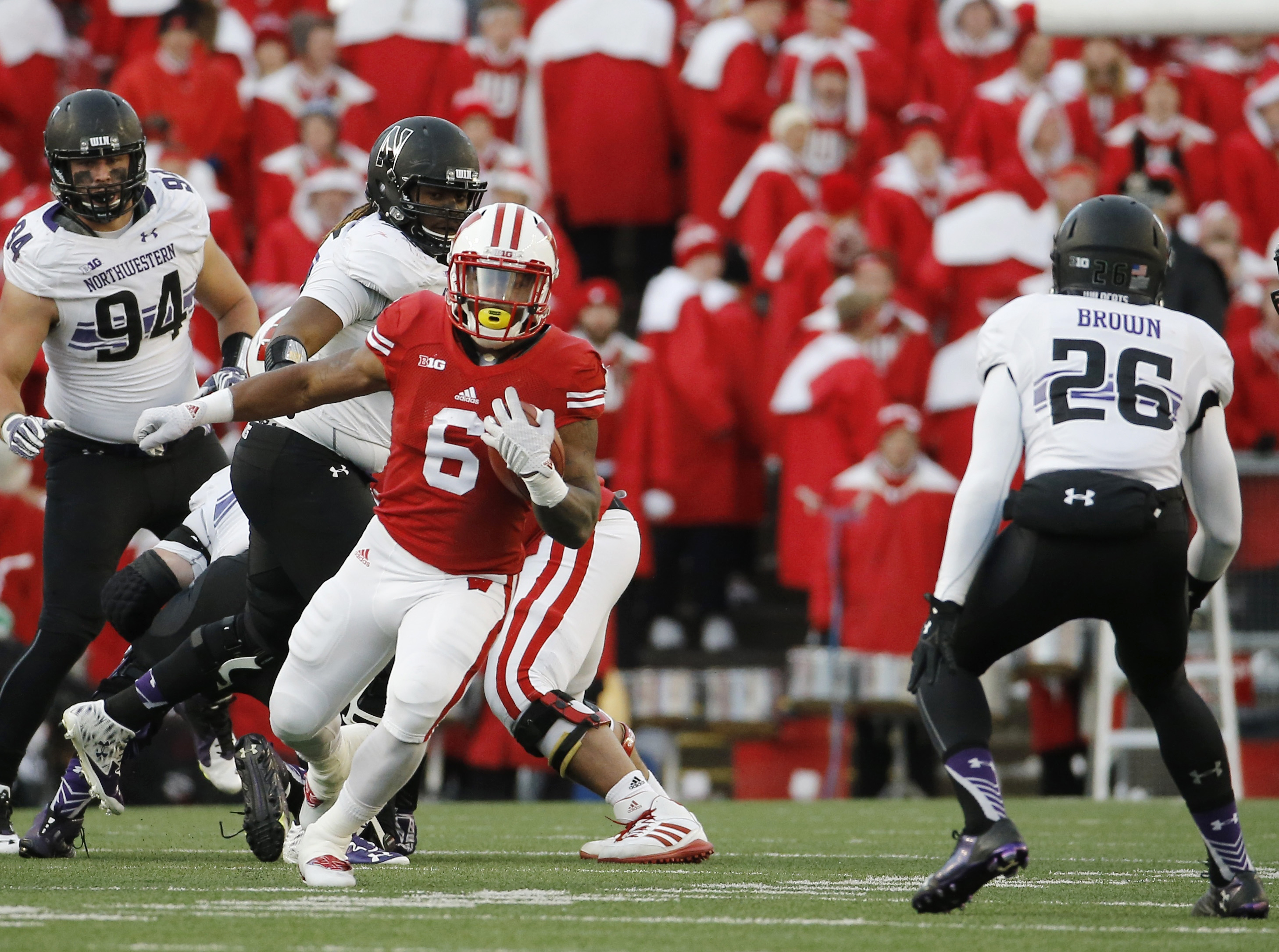 FILE - In this Nov. 21, 2015 file photo, Wisconsin's Corey Clement runs during an NCAA college football game against Northwestern in Madison, Wis. Wisconsin Clement is making a fresh start with a new number. He has switched to No. 24 in spring practice af