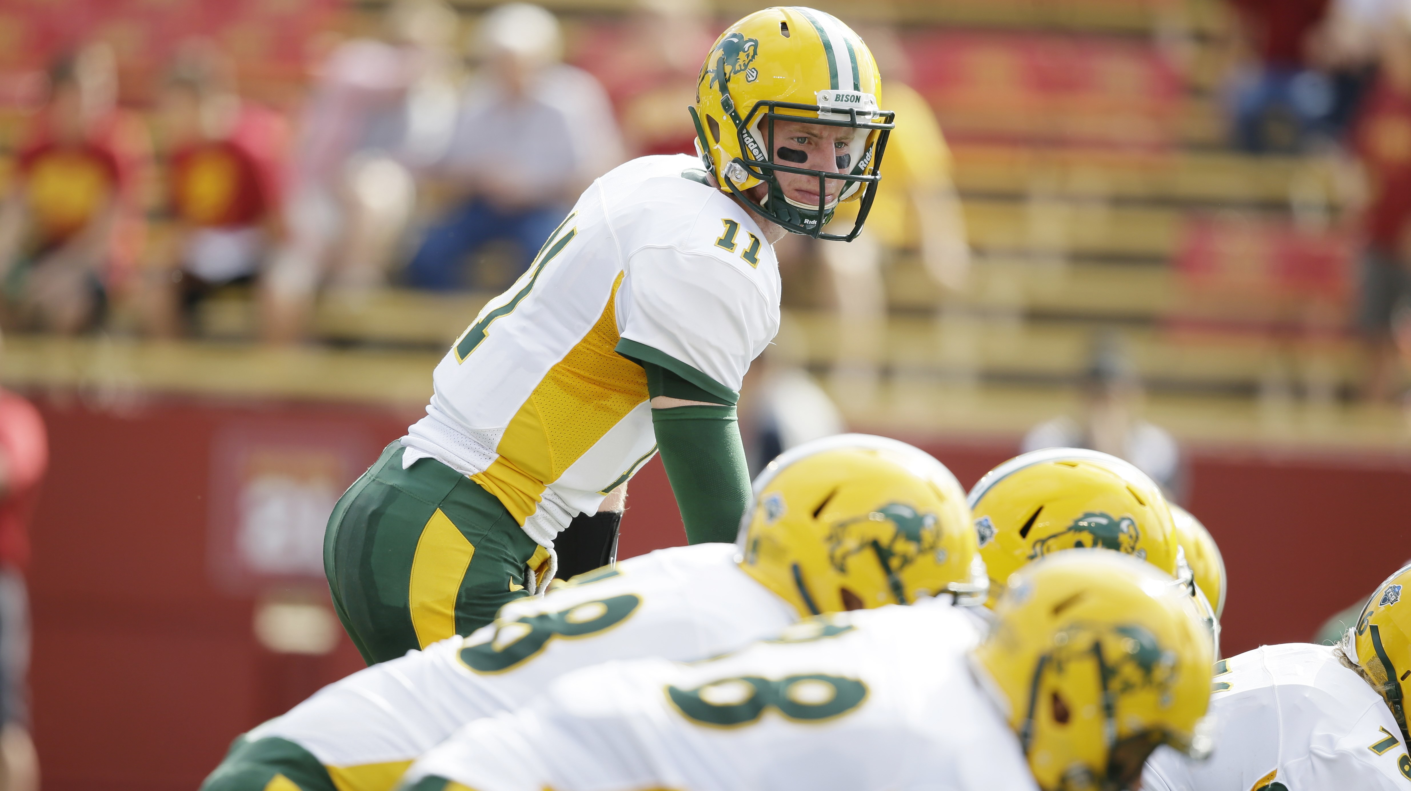 North Dakota State quarterback Carson Wentz (11) warms up before an NCAA college football game against the Iowa State, Saturday, Aug. 30, 2014, in Ames, Iowa. (AP Photo/Charlie Neibergall)
