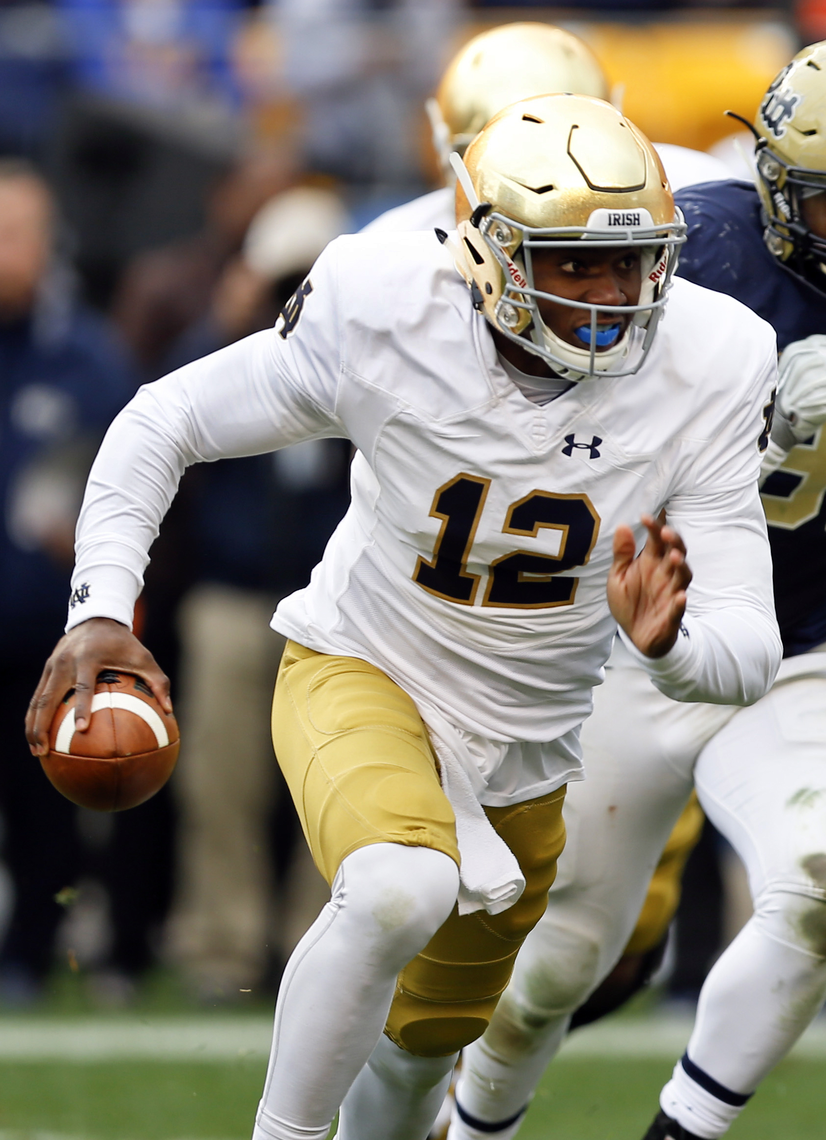FILE - In this Nov. 7, 2015, file photo, Notre Dame quarterback Brandon Wimbush rushes during an NCAA football game against Pittsburgh in Pittsburgh. Wimbush knows he faces a challenge in trying to beat out  DeShone Kizer and Malik Zaire for the starters