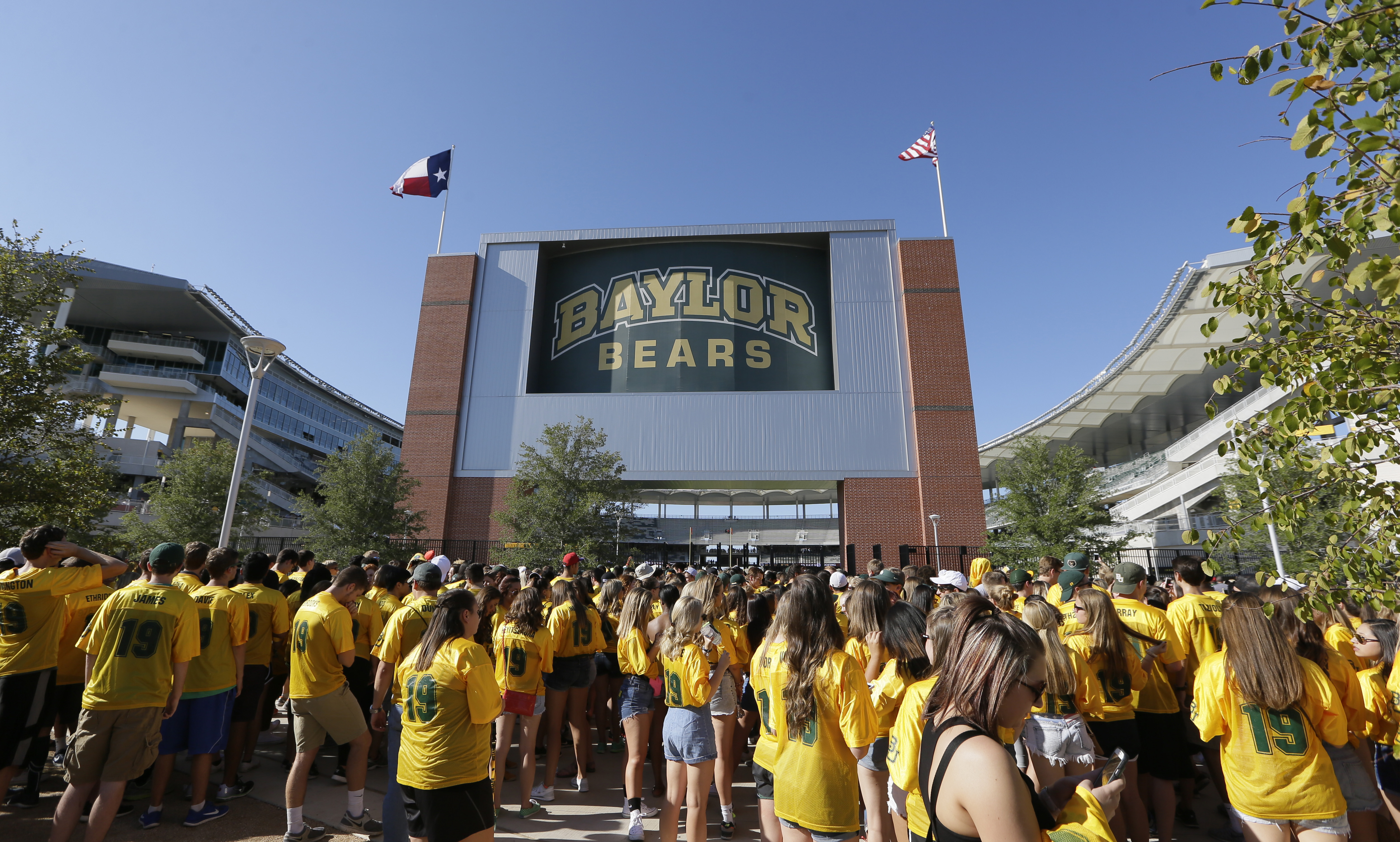 Fans wait to enter the stadium before an NCAA college football game between Lamar and Baylor, Saturday, Sept. 12, 2015, in Waco, Texas. (AP Photo/LM Otero)