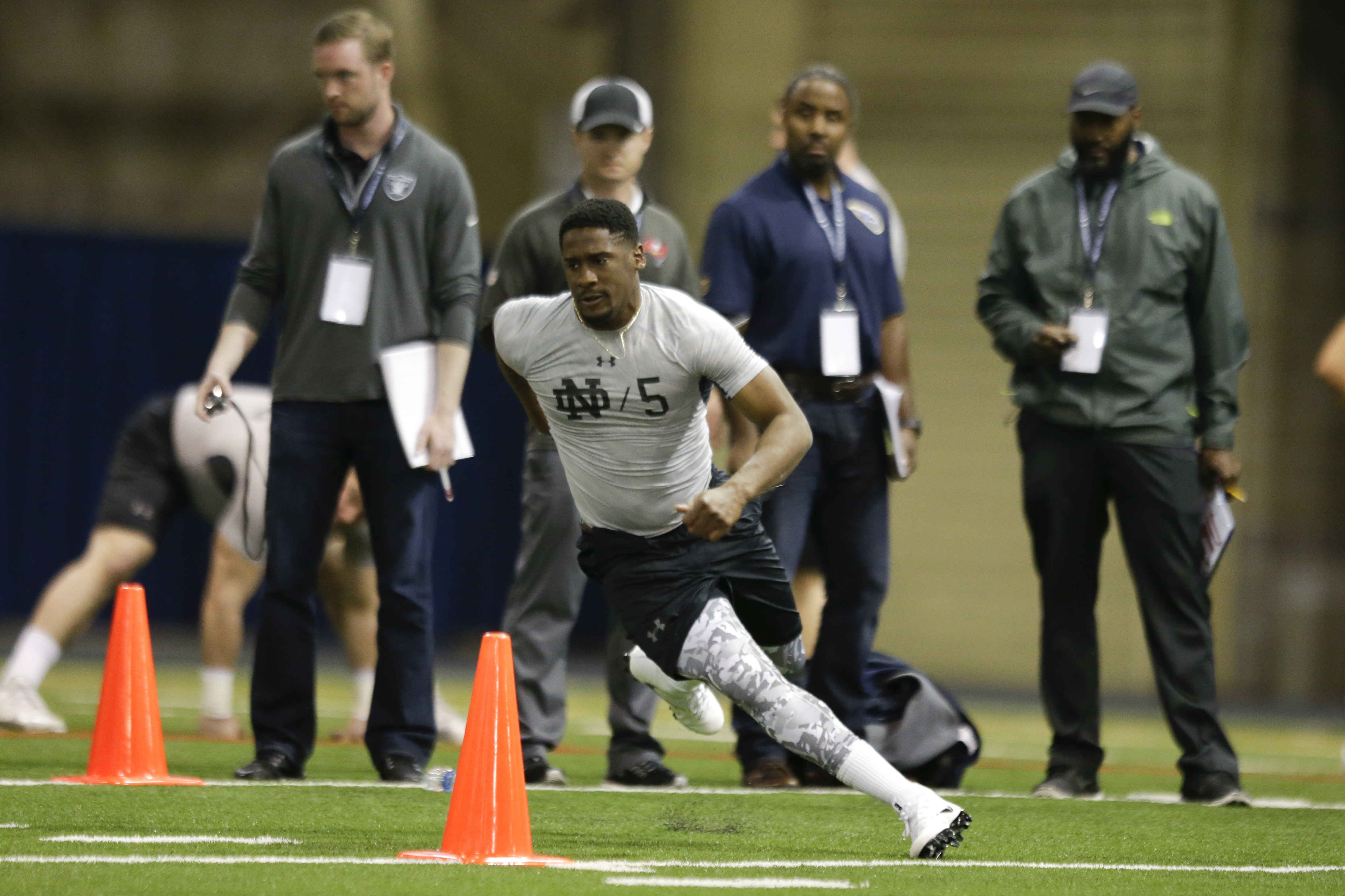 Quarterback Everett Golson runs a drill during Notre Dame's NFL football Pro Day in South Bend, Ind., Thursday, March 31, 2016. (AP Photo/Michael Conroy)