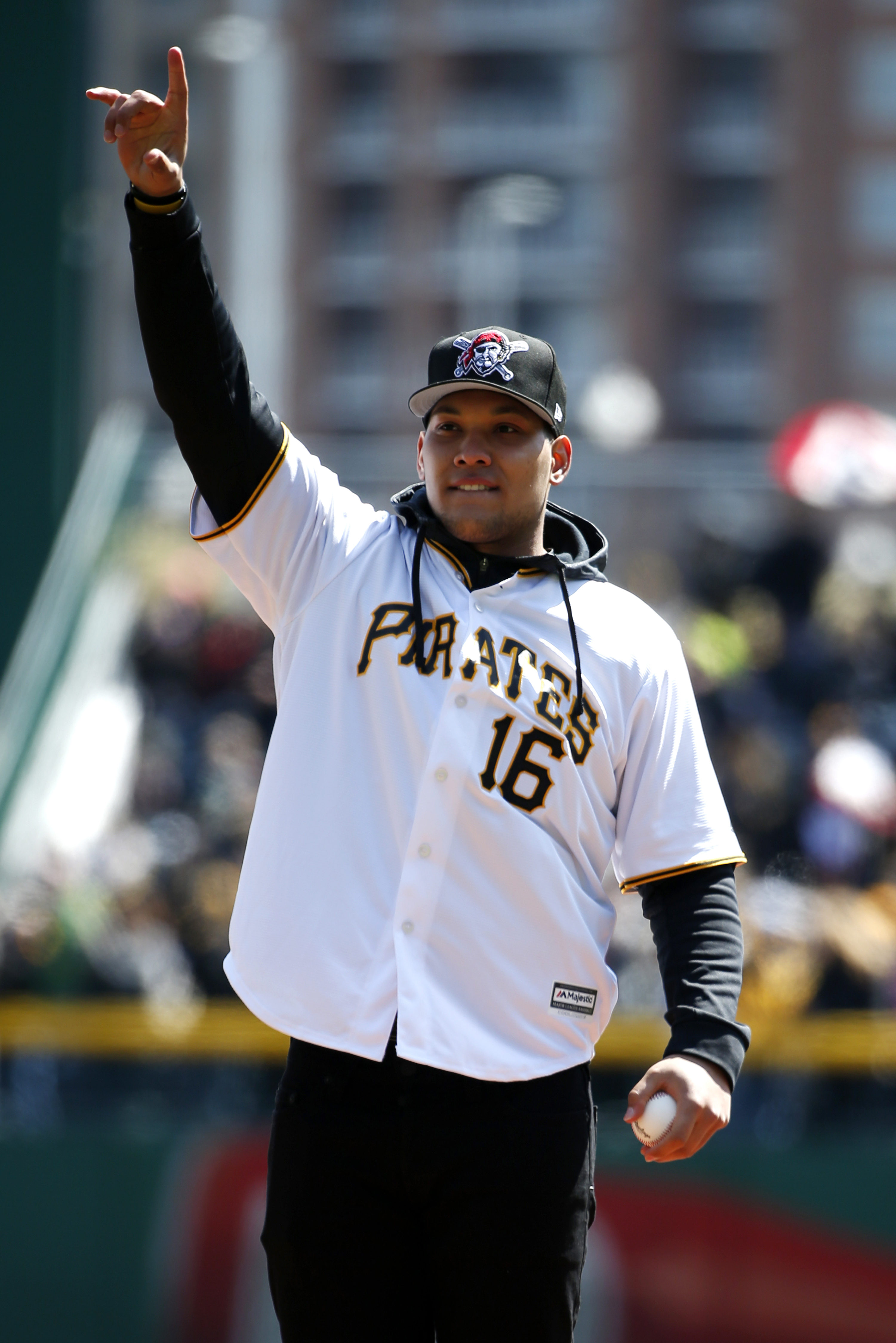 wbbUniversity of Pittsburgh running back James Connor waves from the mound while throwing out the ceremonial first pitch before the first Major League Baseball game of the season between the Pittsburgh Pirates and the St. Louis Cardinals in Pittsburgh, Su
