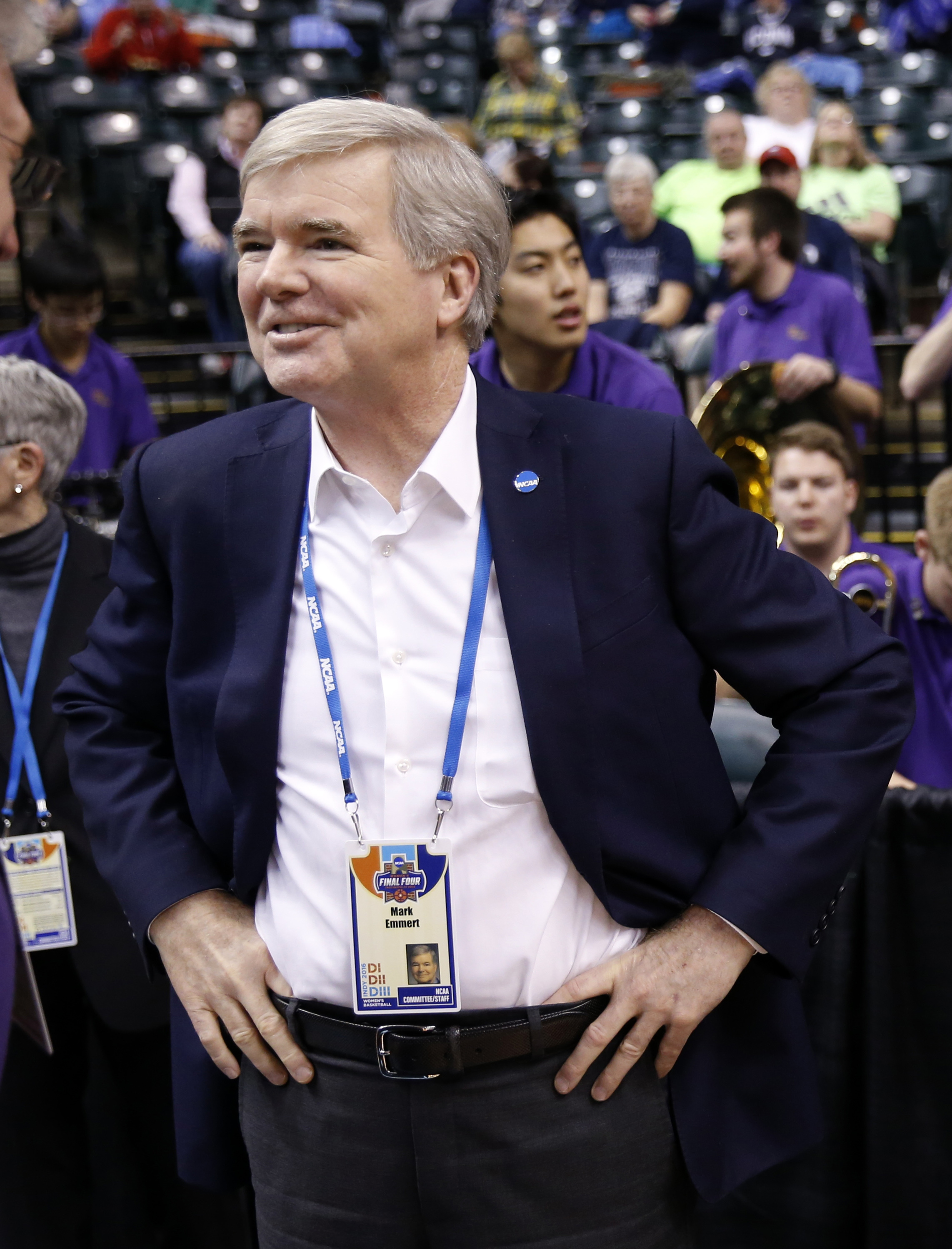 NCAA President Mark Emmert waits for the start of a national semifinal game between Syracuse and Washington, at the women's Final Four in the NCAA college basketball tournament Sunday, April 3, 2016, in Indianapolis. (AP Photo/AJ Mast)