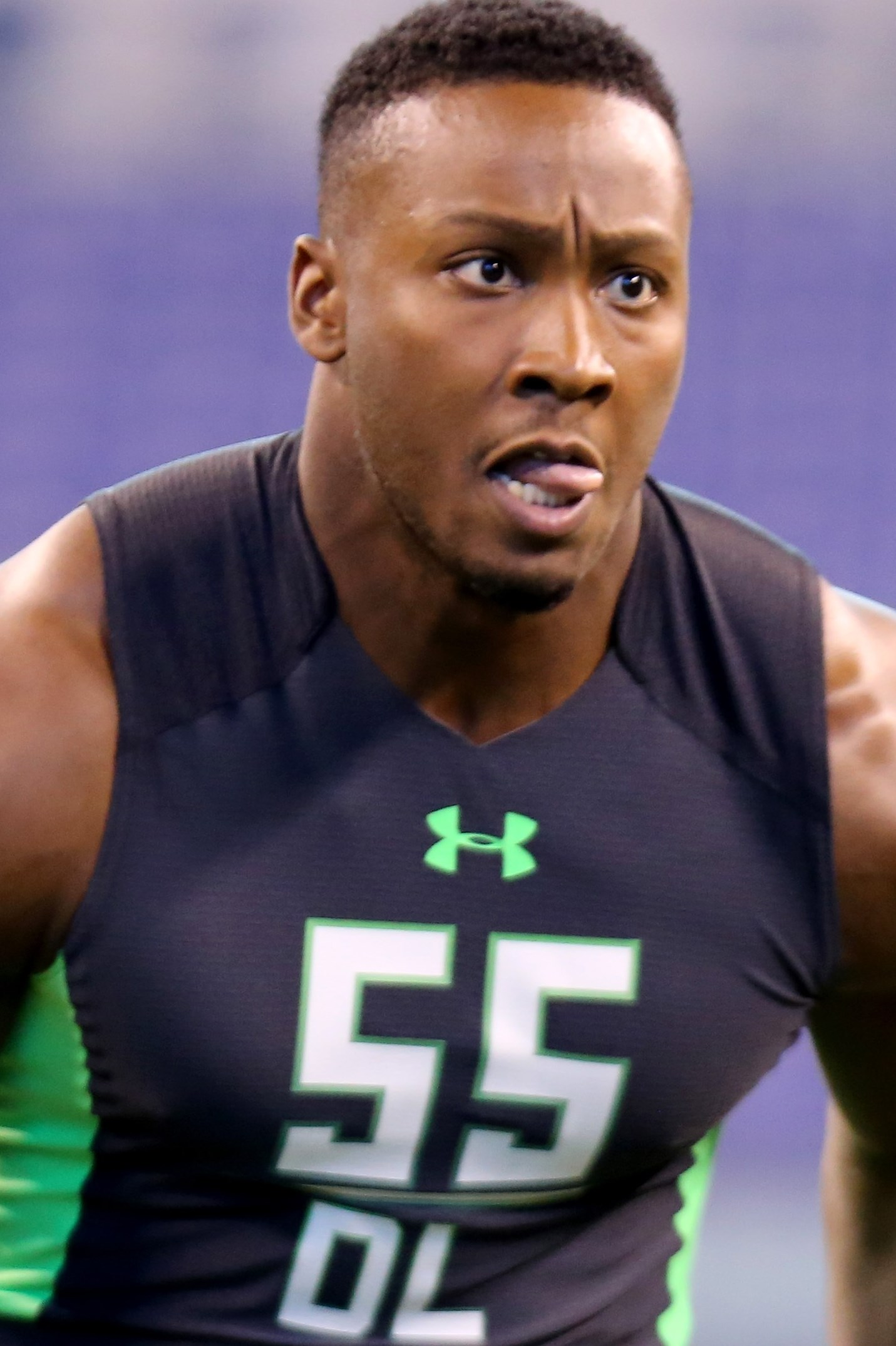 Eastern Kentucky defensive lineman Noah Spence performs a drill at the NFL football scouting combine Sunday, Feb. 28, 2016, in Indianapolis. (AP Photo/Gregory Payan)