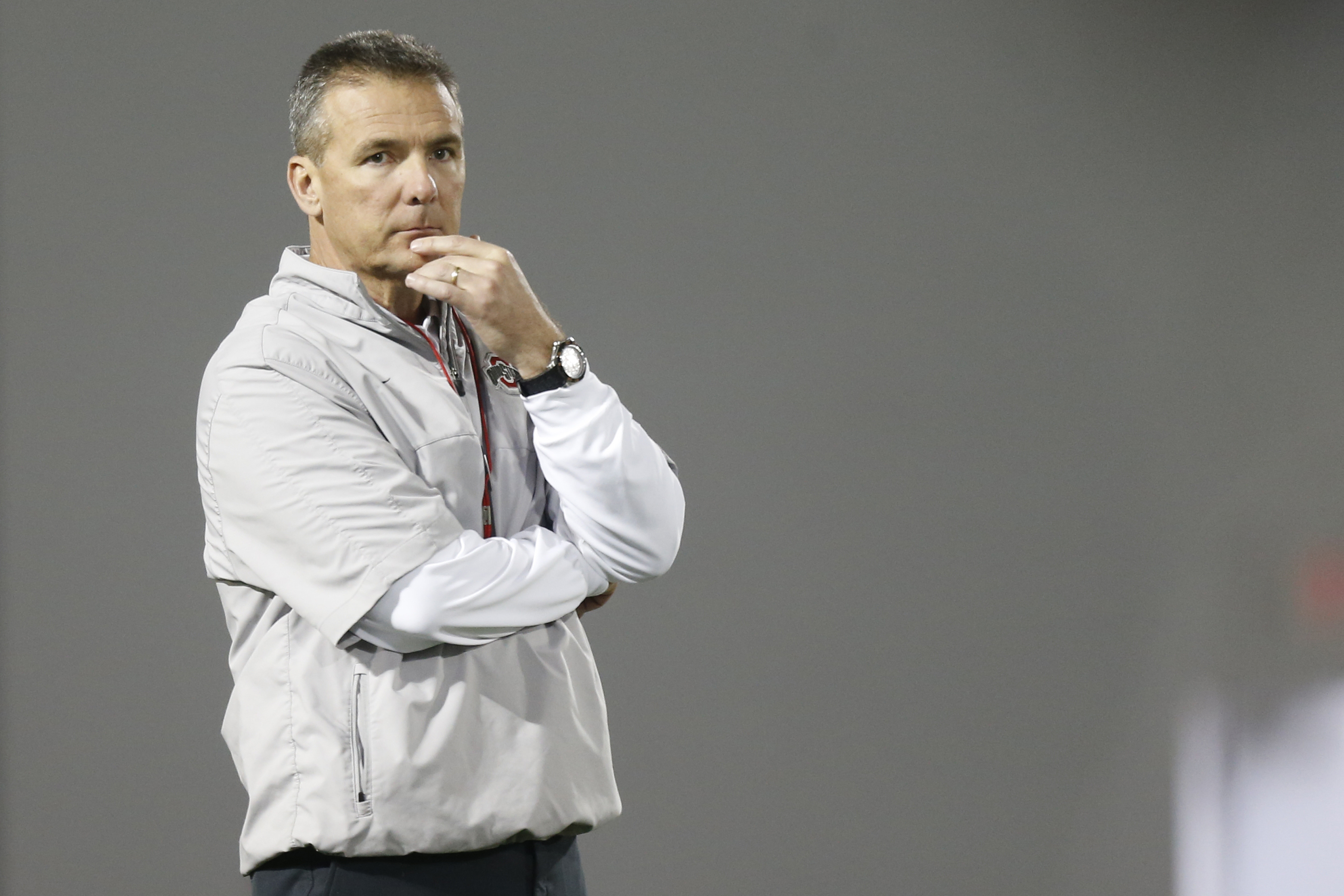 FILE - In this March 8, 2016, file photo, Ohio State coach Urban Meyer watches NCAA college football practice in Columbus, Ohio. Of all the holes hes got to fill in Ohio States starting lineup this fall, Meyer recently has talked about the offensive and d