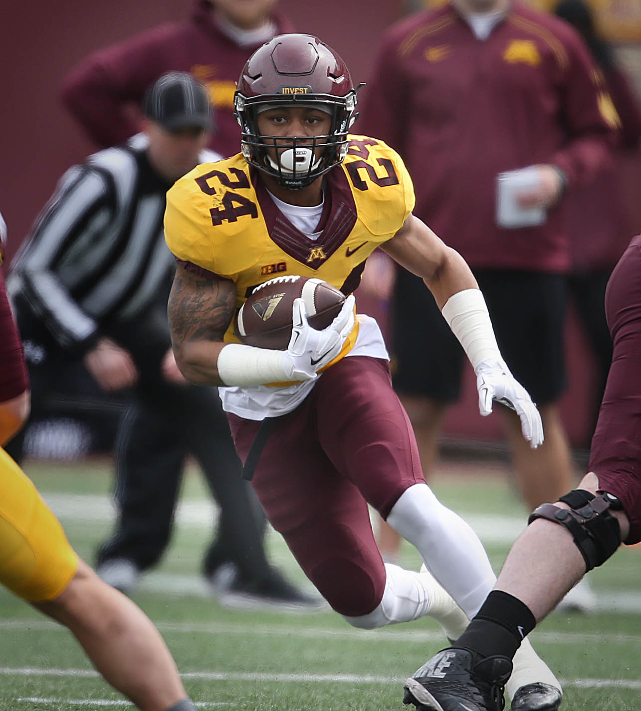 Minnesota's gold team running back Rodney Smith looked for an opening in a spring NCAA college spring football game in Minneapolis on Saturday, April 9, 2016. (Jim Gehrz/Star Tribune via AP) MANDATORY CREDIT