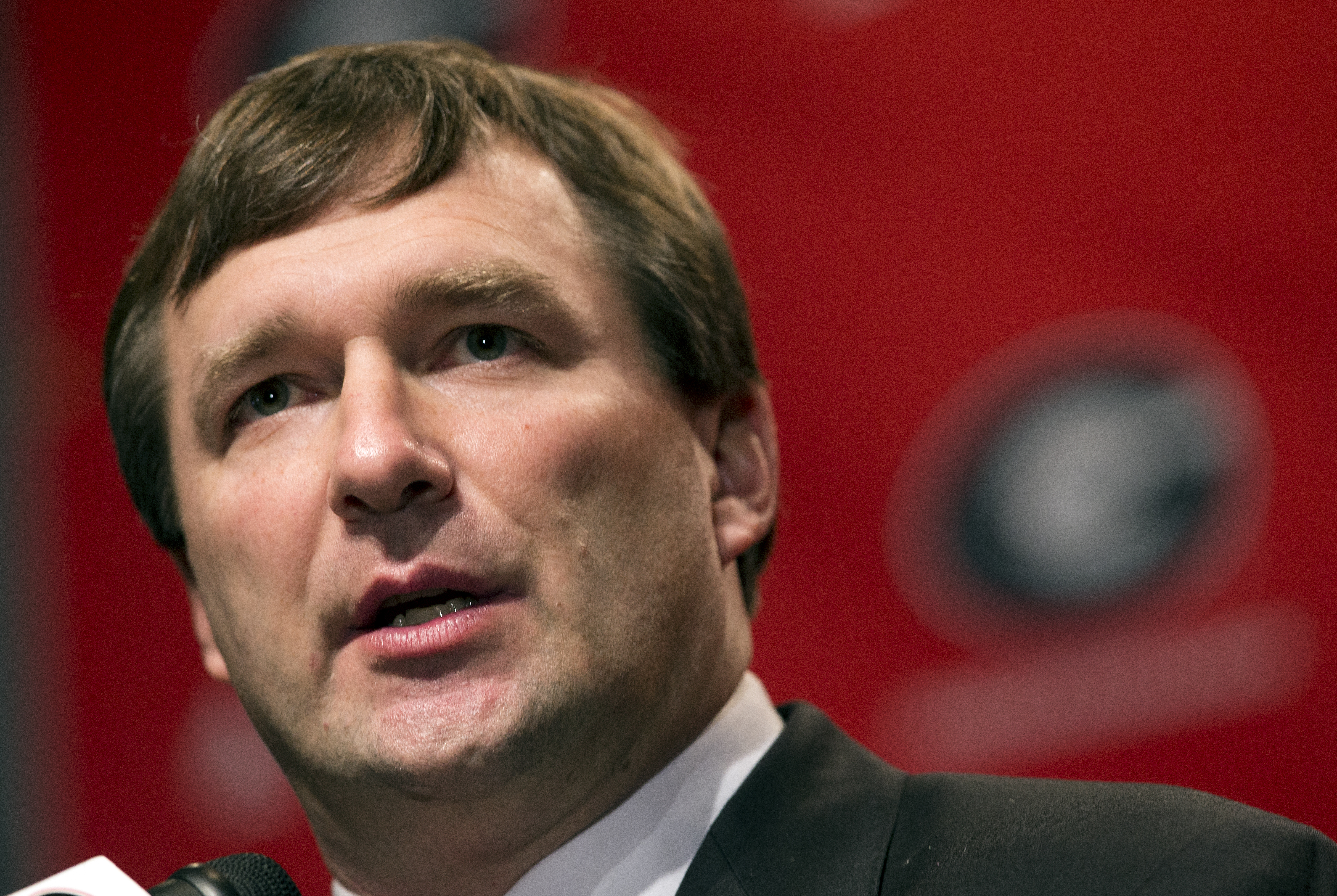 Alabama defensive coordinator Kirby Smart listens to a question from a reporter during a press conference where he was introduced as Georgia's new head football coach  Monday, Dec. 7, 2015, in Athens, Ga. Smart will stay with the Crimson Tide through the