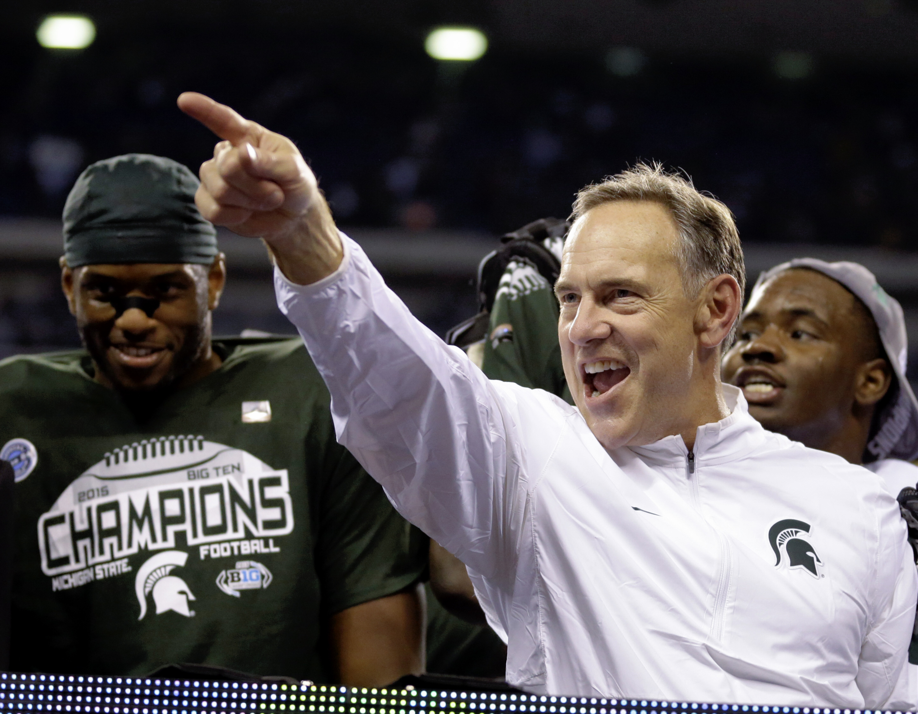 FILE -  In this Dec. 5, 2015 file photo, Michigan State coach Mark Dantonio celebrates after Michigan State defeated Iowa 16-13 to win the Big Ten championship NCAA college football game in Indianapolis. Michigan State is trying to win back-to-back Big Te